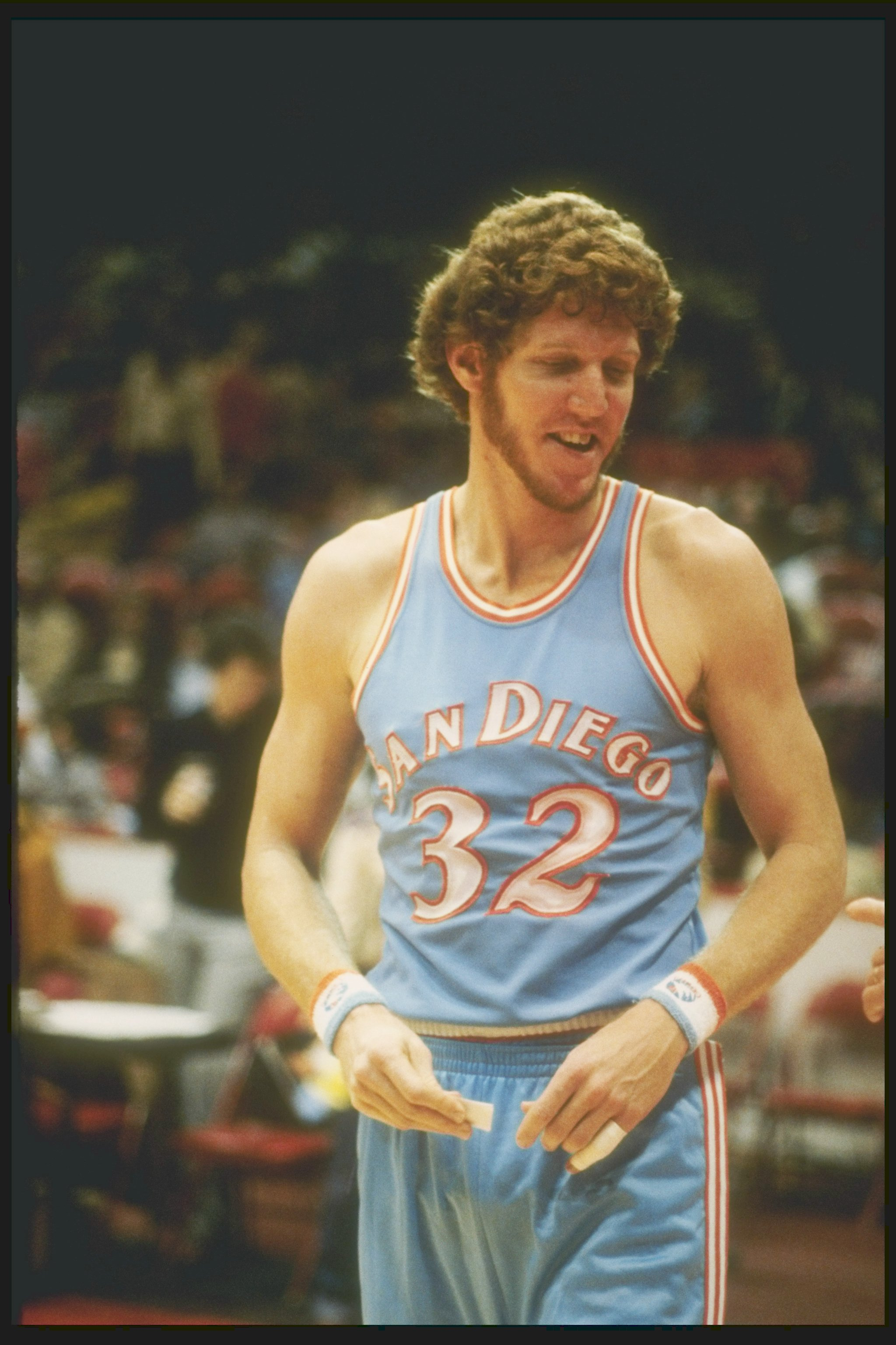 1980:  Center Bill Walton of the San Diego Clippers stands on the court during a game against the Chicago Bulls at Chicago Stadium in Chicago, Illinois.  Mandatory Credit: Jonathan Daniel  /Allsport