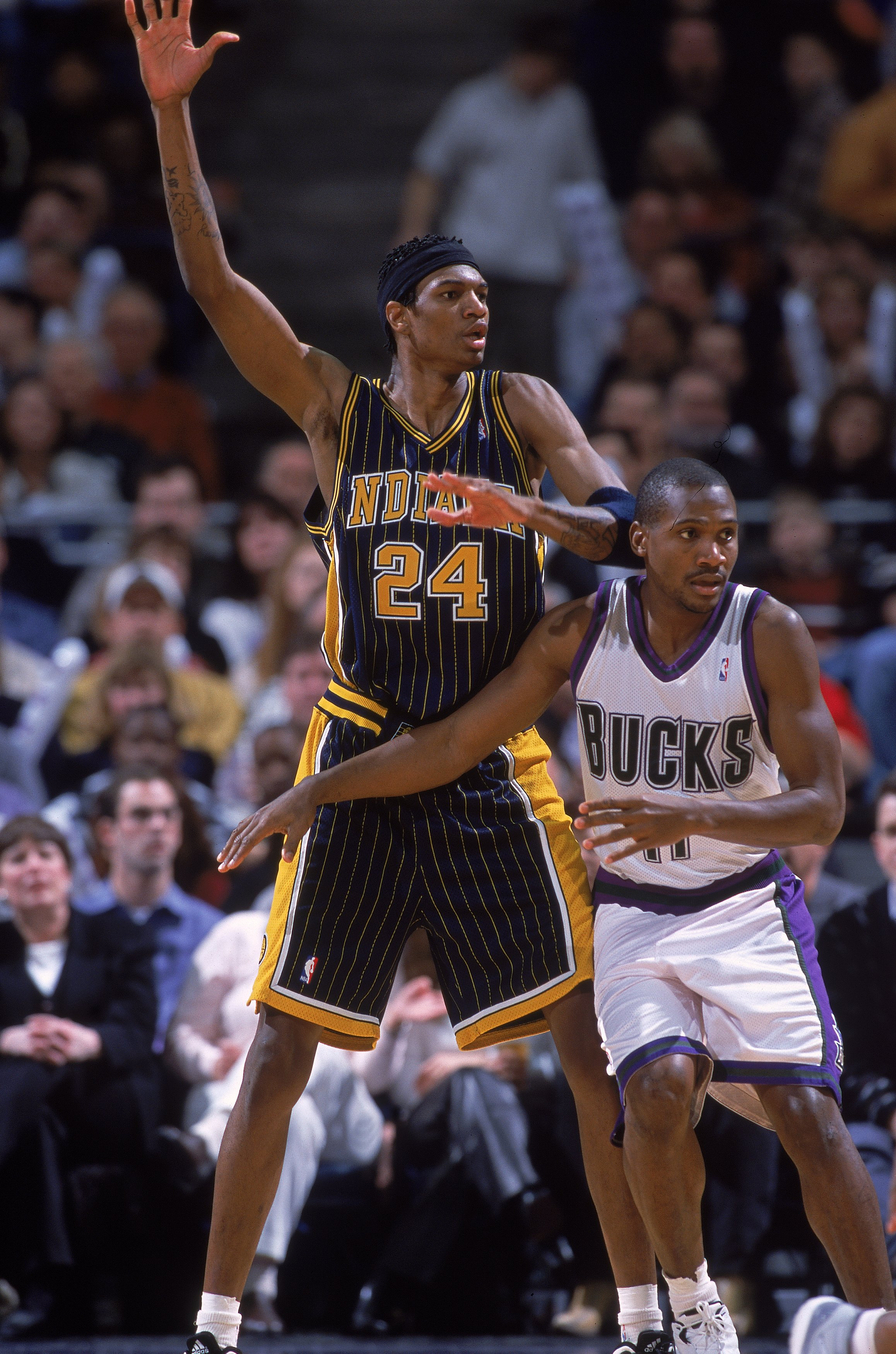 3 Feb 2001:  Jonathan Bender #24 of the Indiana Pacers waves to prove he is open against Lindsey Hunter #11 of the Milwaukee Bucks during the game at the Bradley Center in Milwaukee, Wisconsin. The Bucks defeated the Pacers 104-85.  NOTE TO USER: It is ex