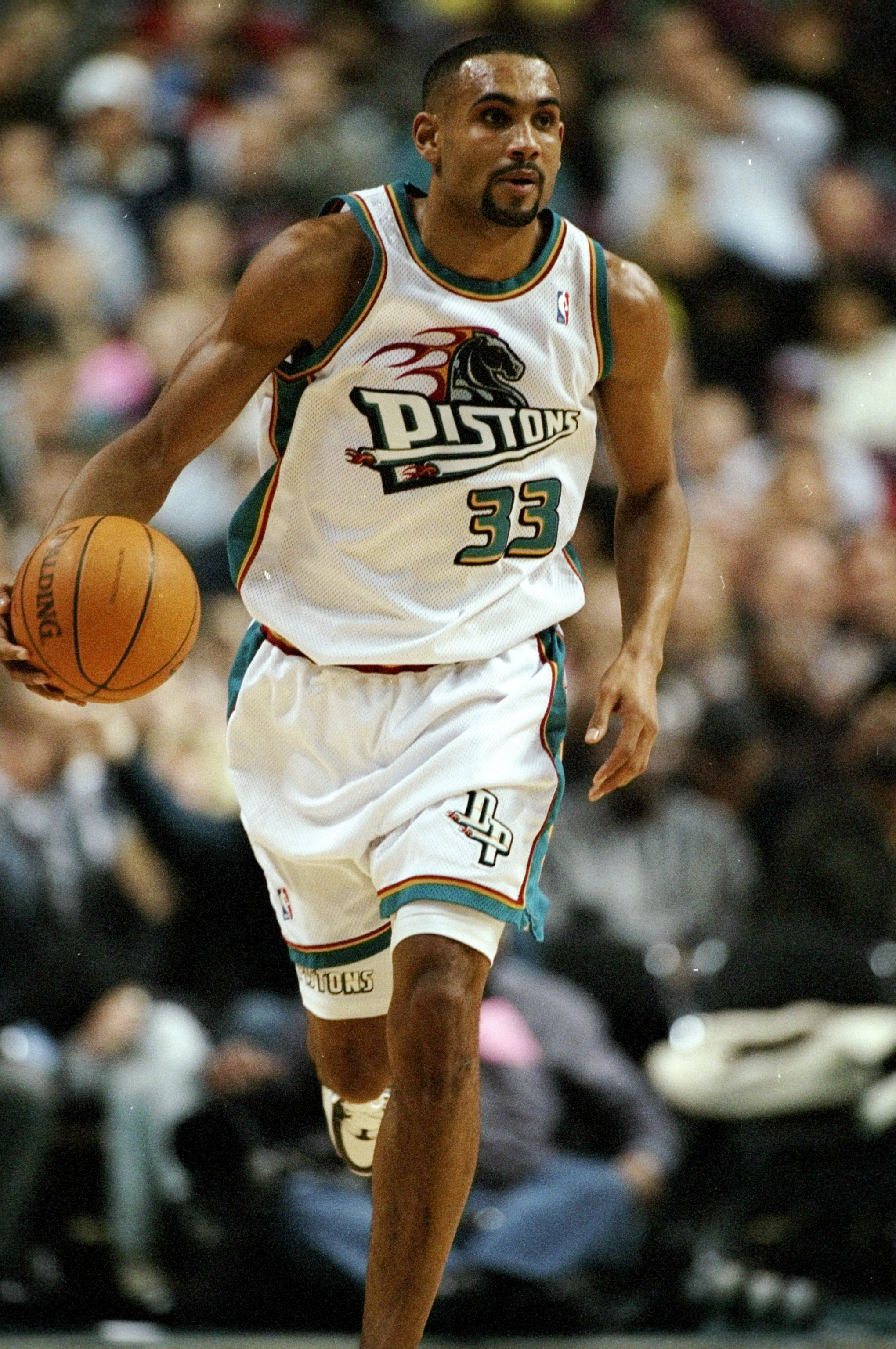 26 Dec 1997:  Grant Hill of the Detroit Pistons runs towards the basket in a match between the Detroit Pistons v Miami Heat in the NBA League played at the Palace of Auburn Hills , Auburn Hills, Miami, USA. Miami Heat won the game 88-74. \ Mandatory Credi
