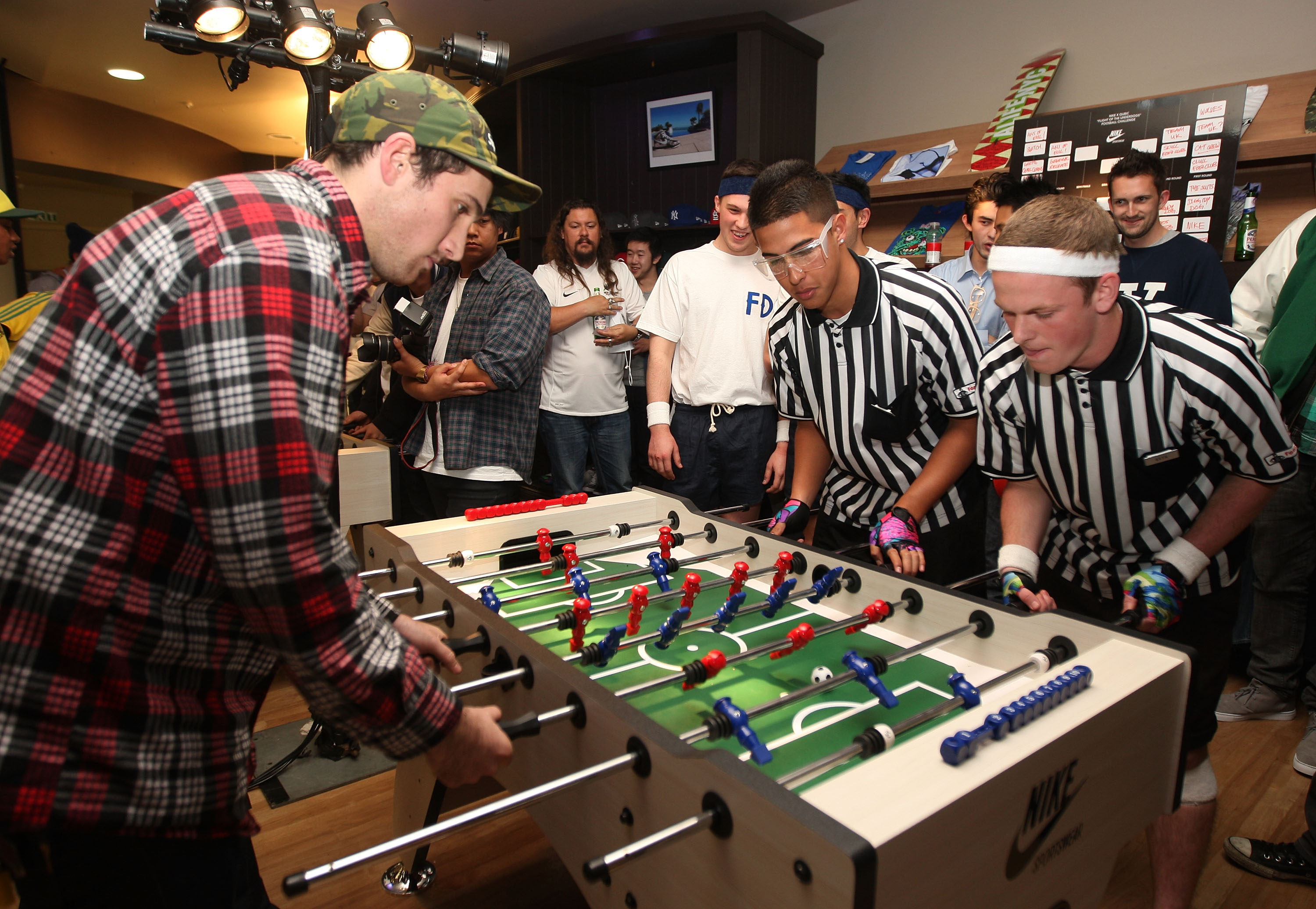 AUCKLAND, NEW ZEALAND - JUNE 15:  All White supporters play foosball inside the retail shop Qubic during a Nike function to watch the match between New Zealand and Slovakia at the 2010 World Cup in South Africa  on June 15, 2010 in Auckland, New Zealand.