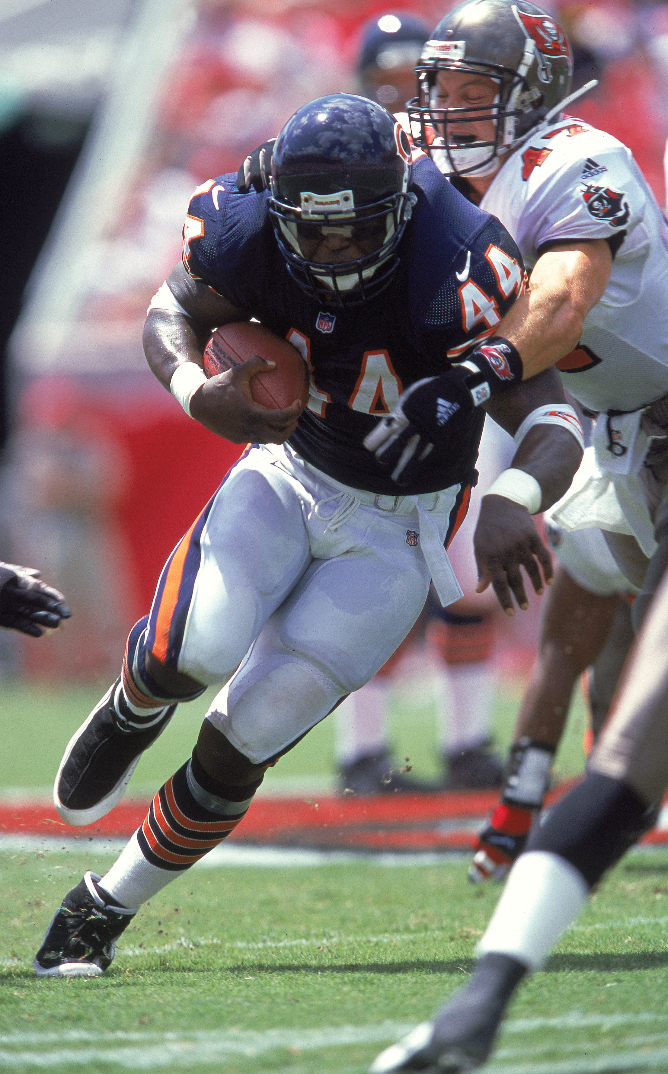 10 Sep 2000:  Curtis Enis #44 of the Chicago Bears breaks out of John Lynch #47 of the Tampa Bay Buccaneers (L-R) grasp during the game at the Raymond James Stadium in Tampa, Florida.  The Buccaneers defeated the bears 40-0.Mandatory Credit: Andy Lyons  /