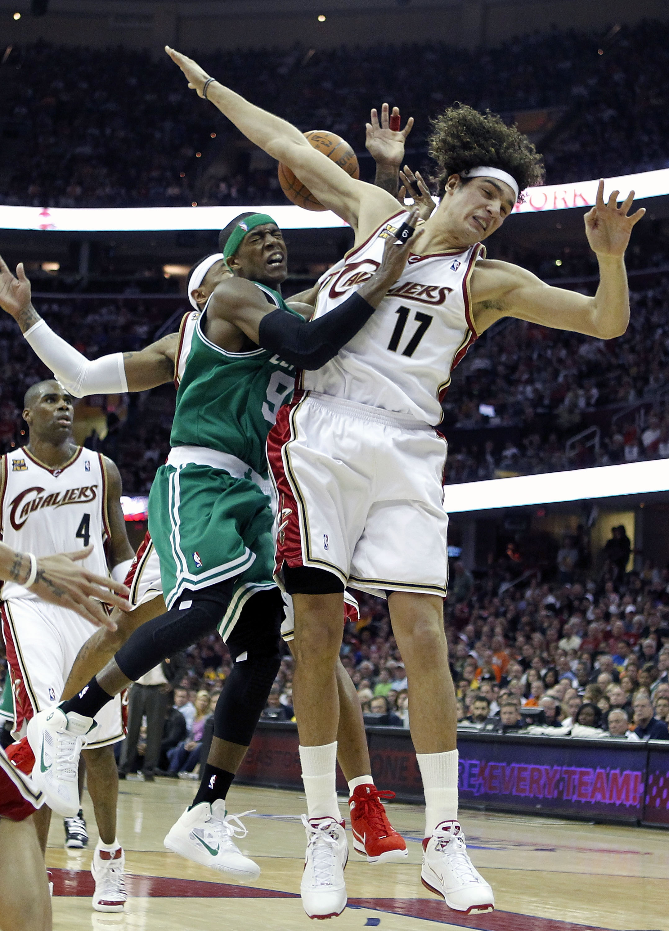 CLEVELAND - MAY 01:  Rajon Rondo #9 of the Boston Celtics tries to get a shot off between Mo Williams #2 and Anderson Varejao #17 of the Cleveland Cavaliers in Game One of the Eastern Conference Semifinals during the 2010 NBA Playoffs at Quicken Loans Are