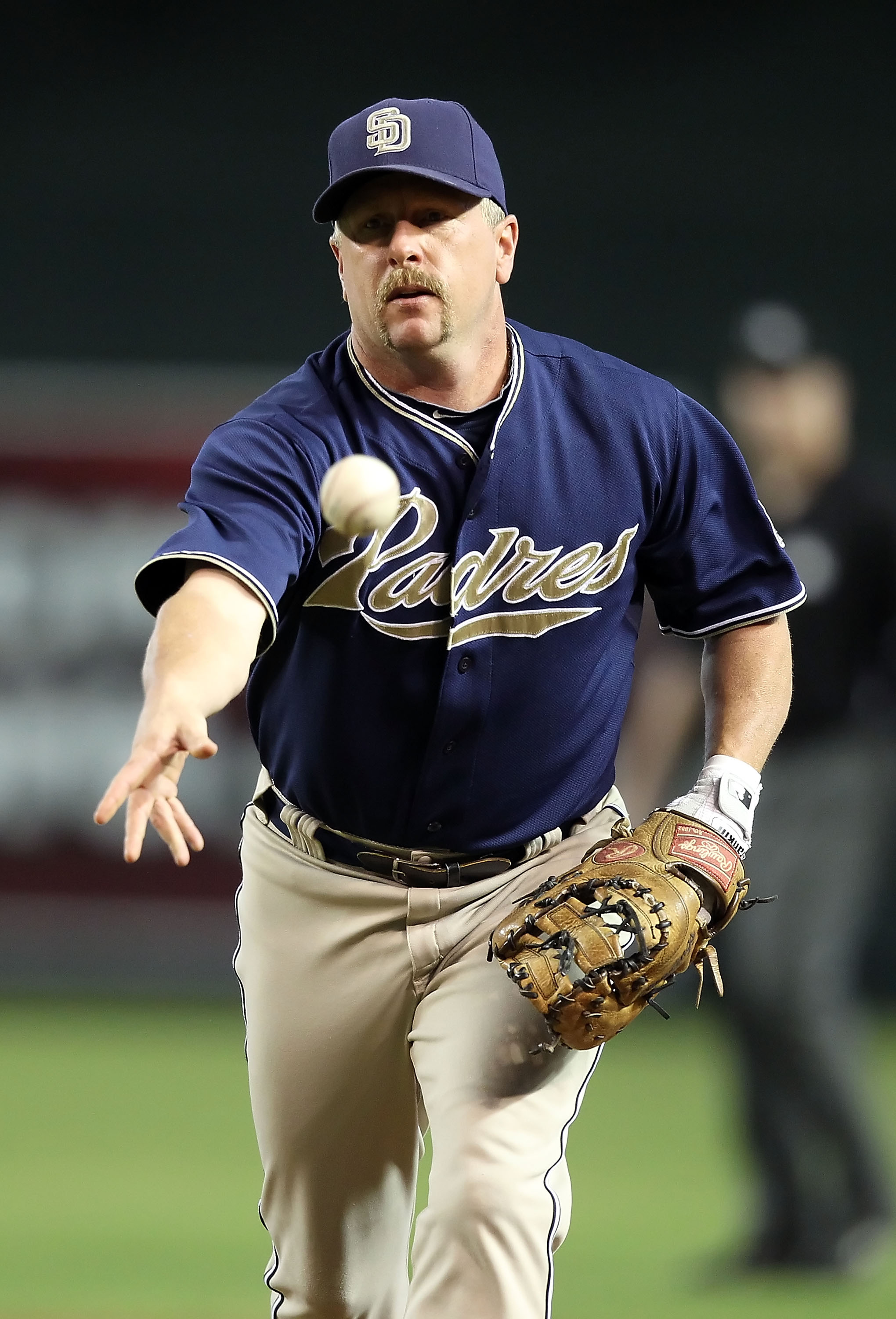 PHOENIX - AUGUST 08:  Infielder Matt Stairs #16 of the San Diego Padres fields a ground ball out agianst the Arizona Diamondbacks during the Major League Baseball game at Chase Field on August 8, 2010 in Phoenix, Arizona.  (Photo by Christian Petersen/Get