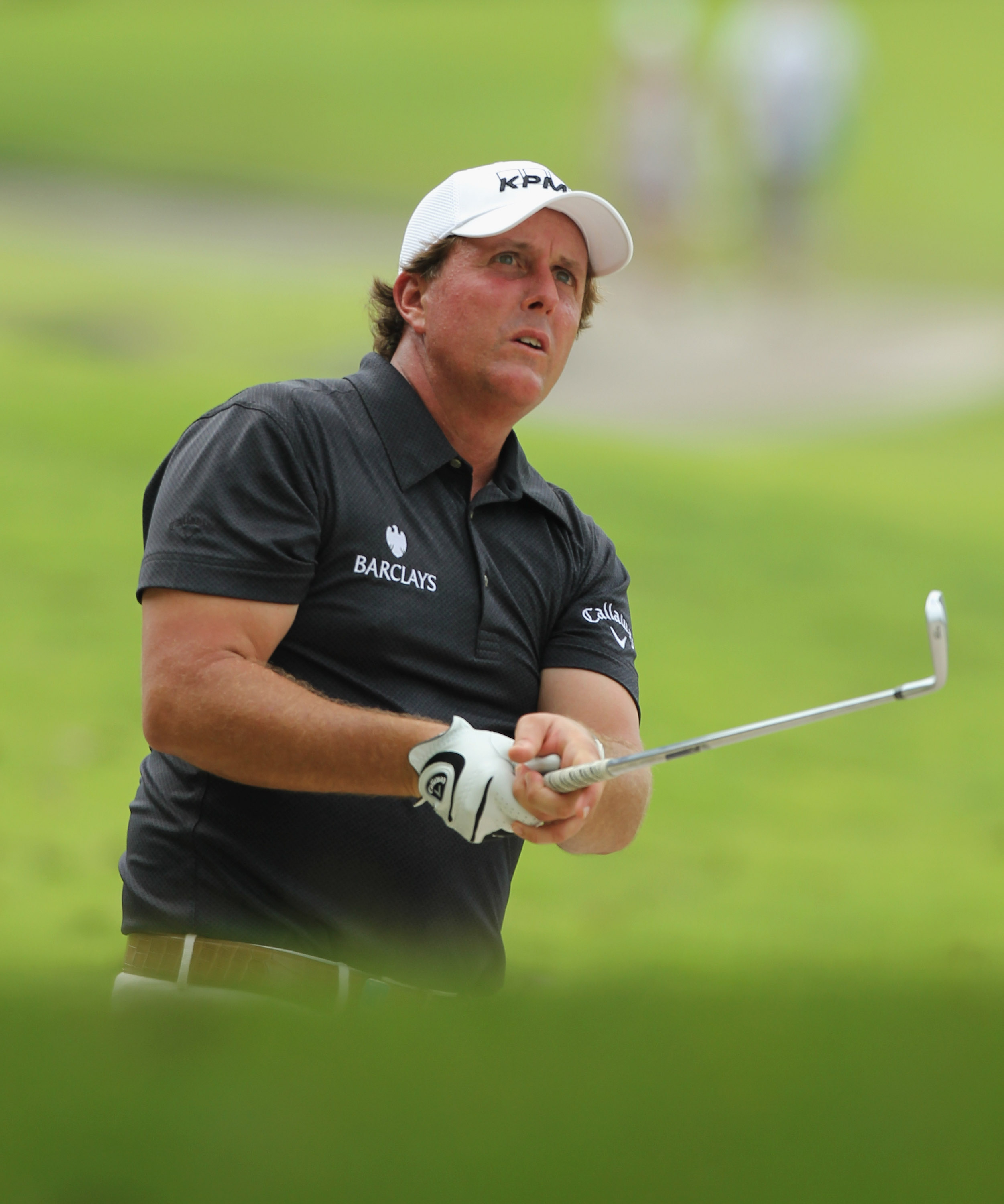 SINGAPORE - NOVEMBER 13: Phil Mickelson of USA watches his 2nd shot on the 18th hole during the Third Round of the Barclays Singapore Open held at the Sentosa Golf Club on November 13, 2010 in Singapore, Singapore.  (Photo by Stanley Chou/Getty Images)