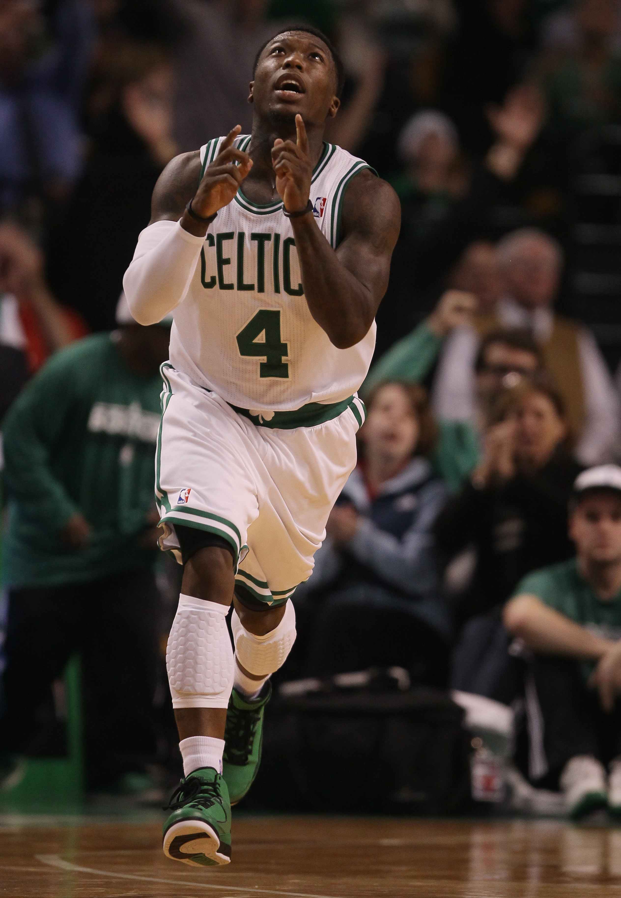 BOSTON - NOVEMBER 05:  Nate Robinson #4 of the Boston Celtics celebrates his three pointer in the second half against the Chicago Bulls on November 5, 2010 at the TD Garden in Boston, Massachusetts. The Celtics defeated the Bulls 110-105 in overtime. NOTE