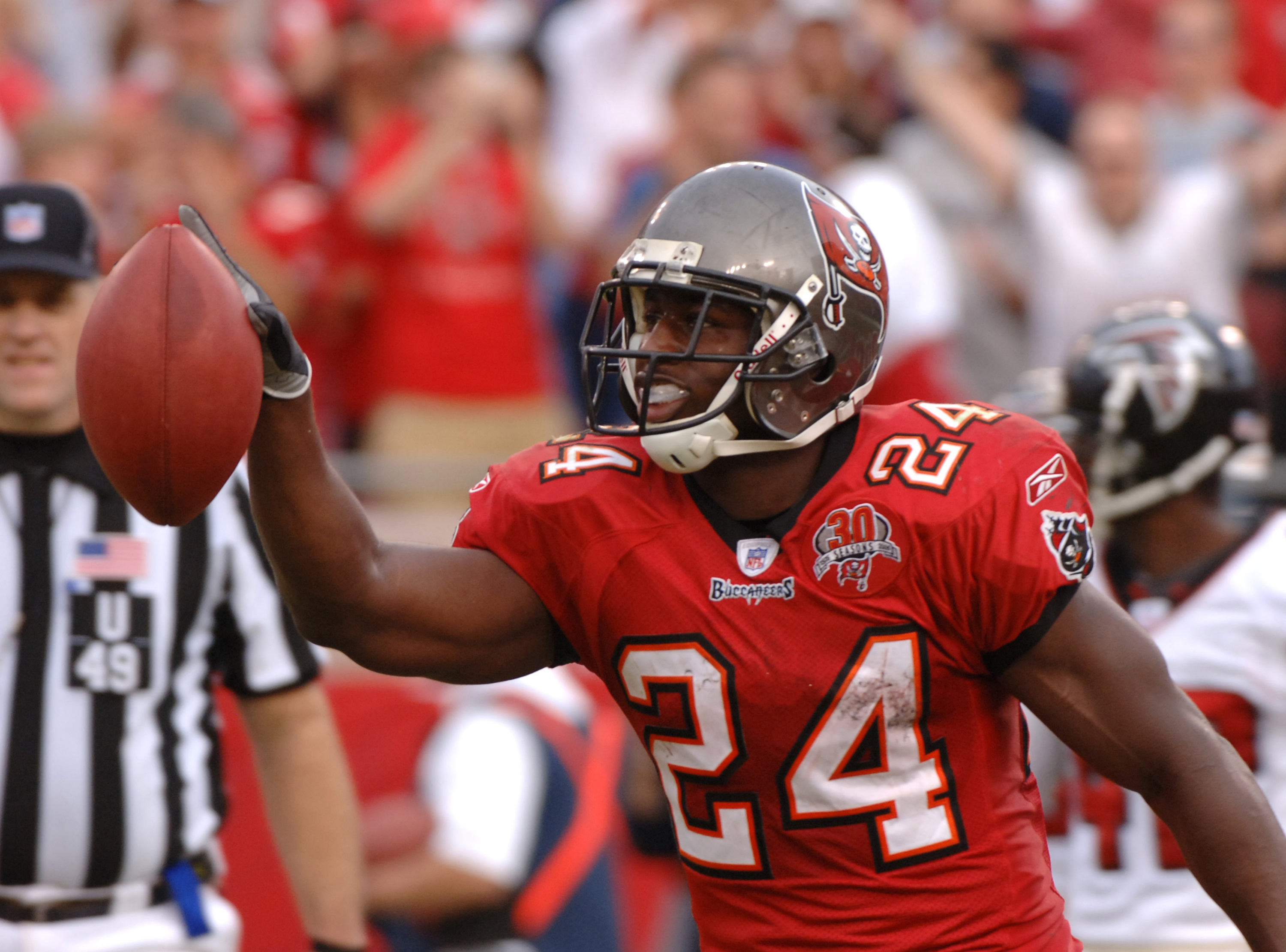 Tampa Bay Buccaneers runnning back Carnell Williams celebrates a touchdown run against the Atlanta Falcons Dec. 24, 2005 in Tampa.  Williams rushed for more than 100 yards as the Bucs won 27 - 23 in overtime.  (Photo by Al Messerschmidt/Getty Images)