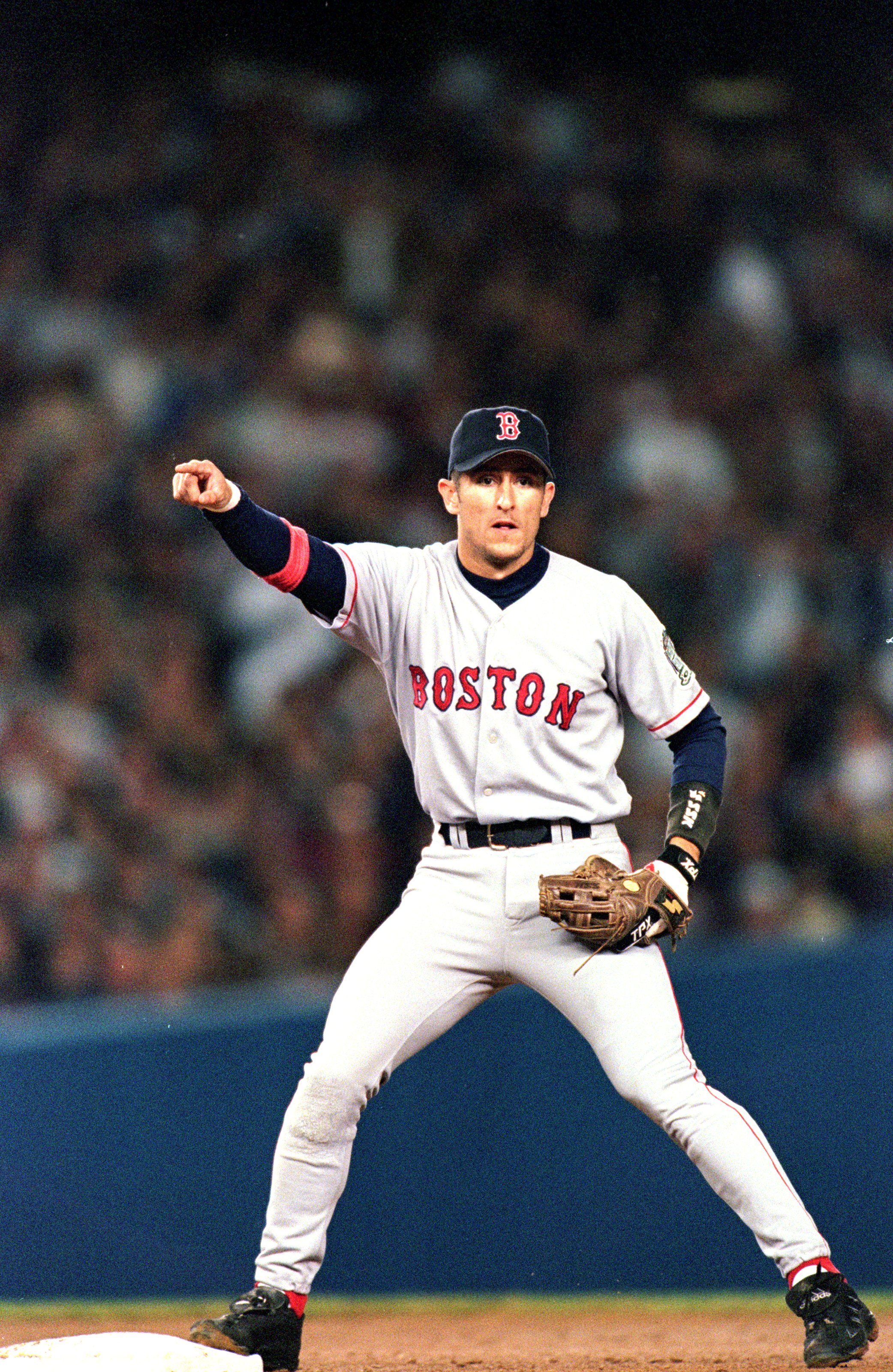 13 Oct 1999:  Nomar Garciaparra #5 of the Boston Red Sox points from the infield during the ALCS game against the New York Yankees at Yankee Stadium in the Bronx, New York. The Yankees defeated the Red Sox 4-3. Mandatory Credit: Ezra O. Shaw  /Allsport