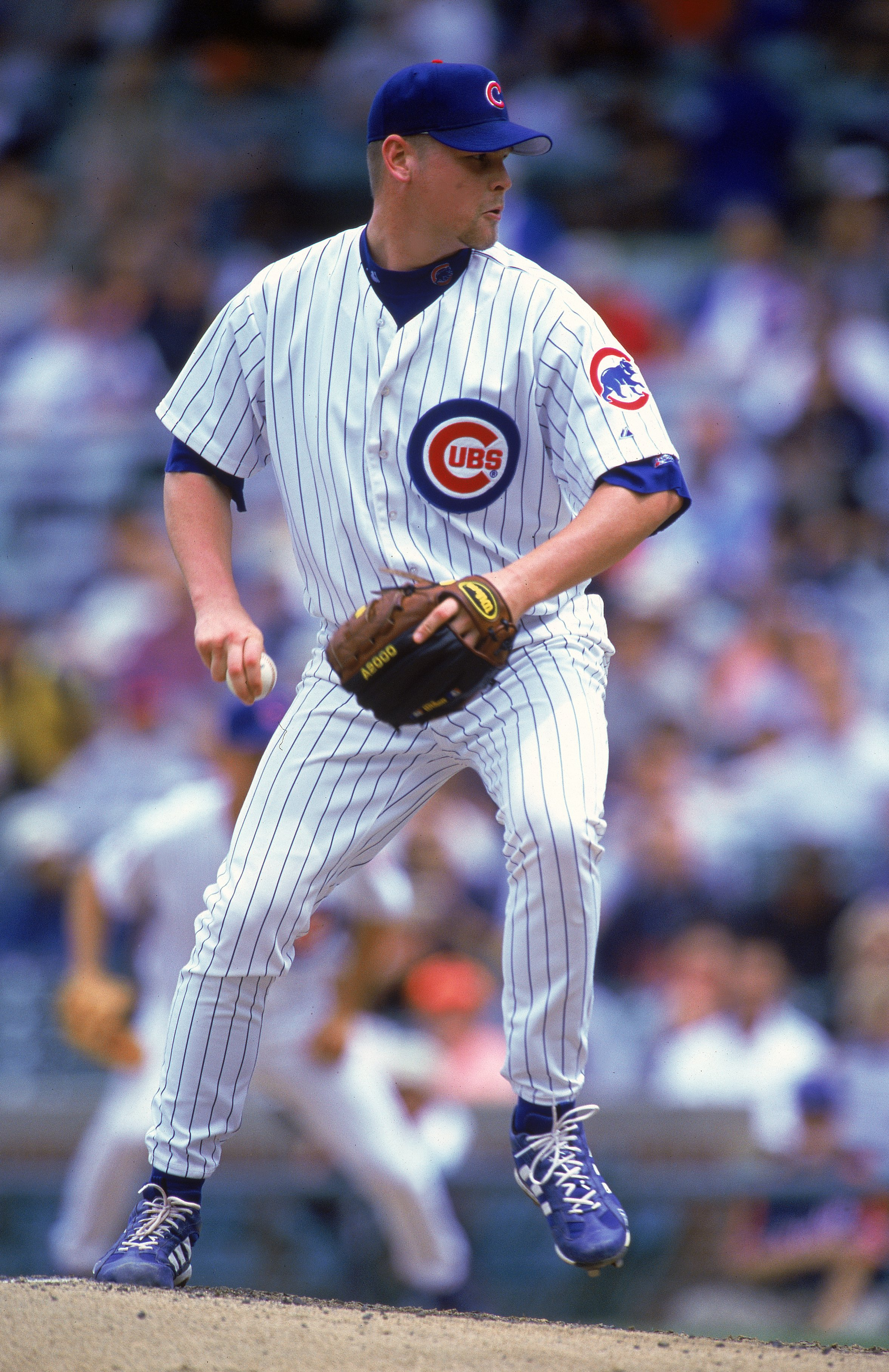 16 Jun 2000:  Pitcher Kerry Wood #34 of the Chicago Cubs winds up for the pitch during the game against the Montreal Expos at Wrigley Field in Chicago, Illinois.  The Cubs defeated the Expos 9-8.Mandatory Credit: Jonathan Daniel  /Allsport