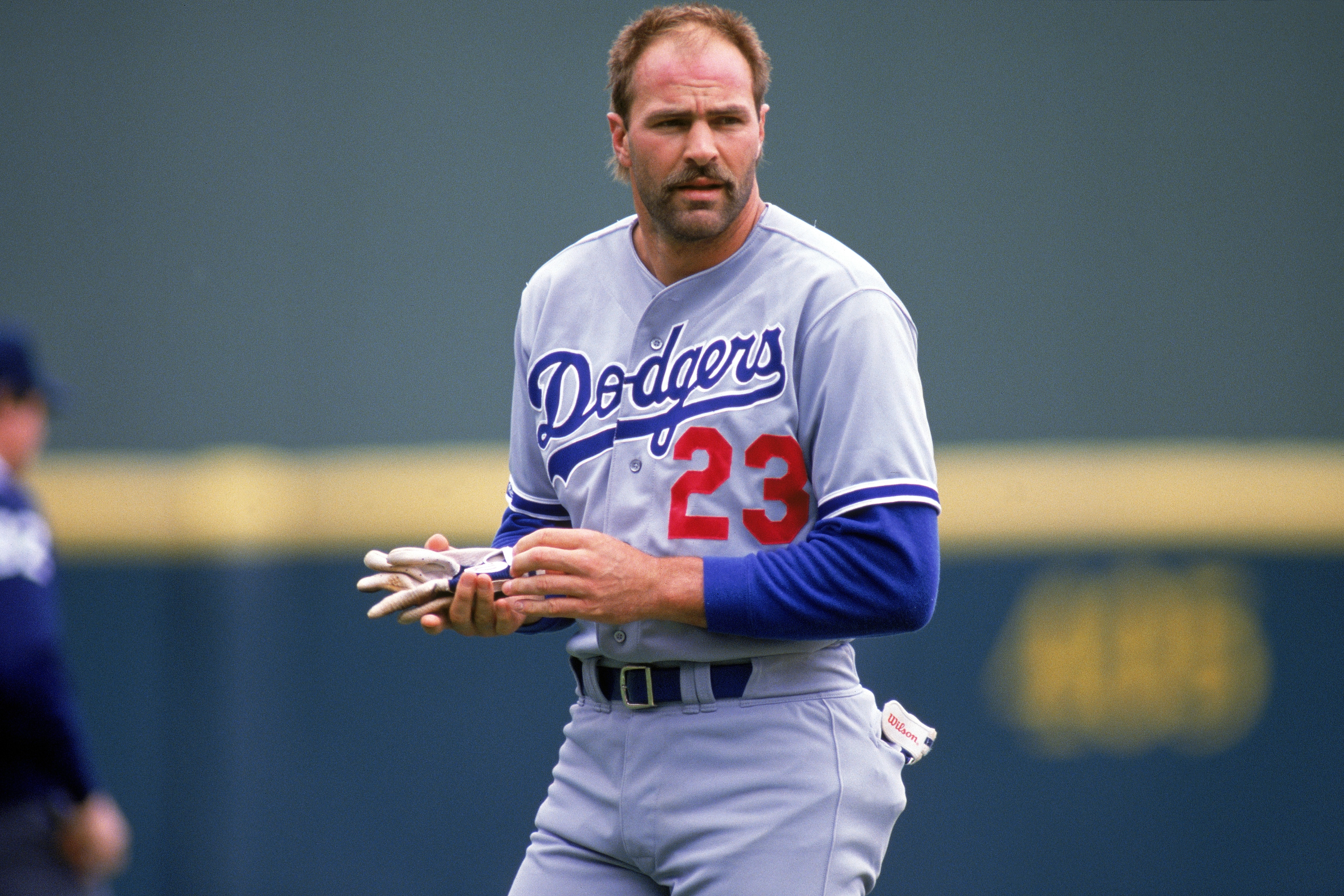 SAN DIEGO - 1988:  Outfielder Kirk Gibson #23 of the Los Angeles Dodgers with his helmet off during a 1988 season game against the San Diego Padres at Jack Murphy Stadium in San Diego, California.  (Photo by Stephen Dunn/Getty Images)