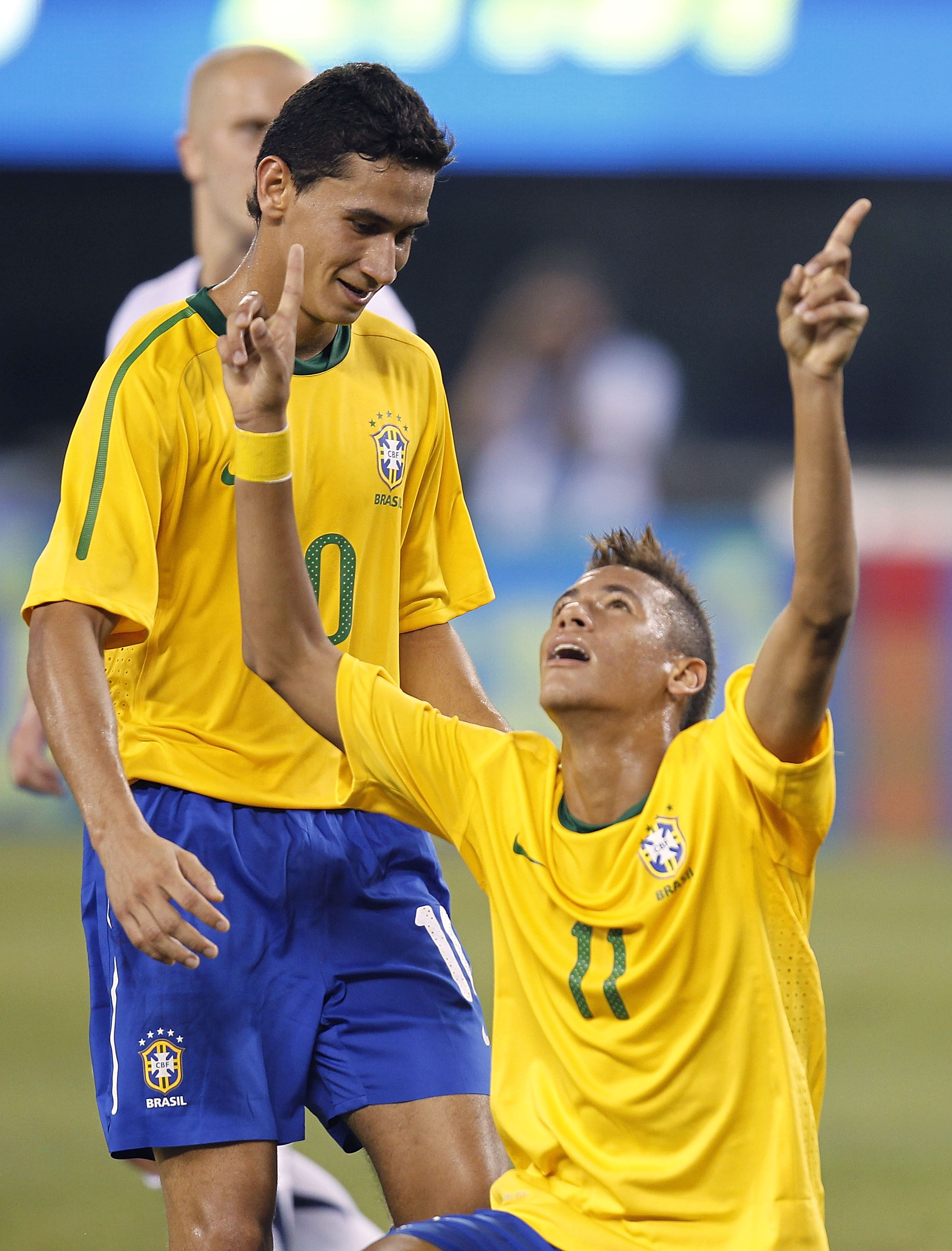 EAST RUTHERFORD, NJ - AUGUST 10: Neymar #11 and Paulo Henrique Ganso #10 of Brazil celebrate Neymar's goal against the U.S. in the first half of a friendly match at the New Meadowlands on August 10, 2010 in East Rutherford, New Jersey. (Photo by Jeff Zele