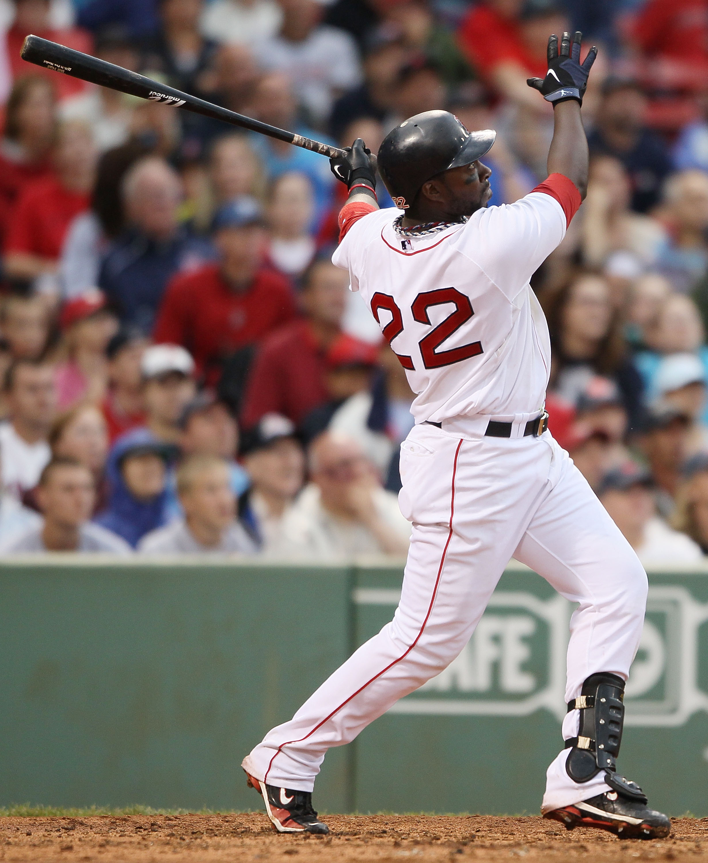 BOSTON - AUGUST 22:  Bill Hall #22 of the Boston Red Sox hits a two run homer in the fifth inning against the Toronto Blue Jays on August 22, 2010 at Fenway Park in Boston, Massachusetts.  (Photo by Elsa/Getty Images)