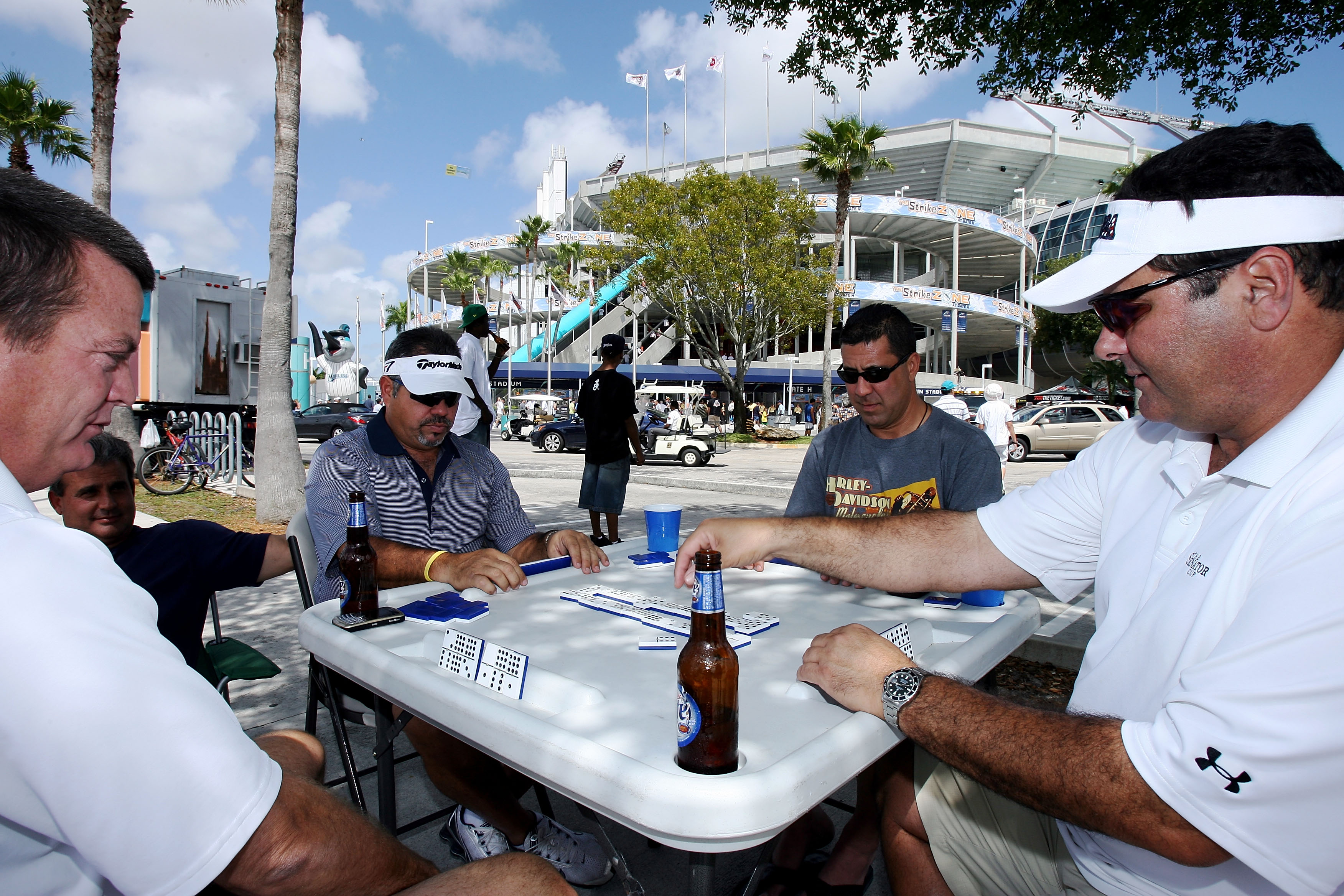 MIAMI - MARCH 31:  Some fans wait for the gate to open by playing dominos prior to the Florida Marlins game against the New York Mets on Opening Day at Dolphin Stadium on March 31, 2008 in Miami, Florida.  (Photo by Doug Benc/Getty Images)