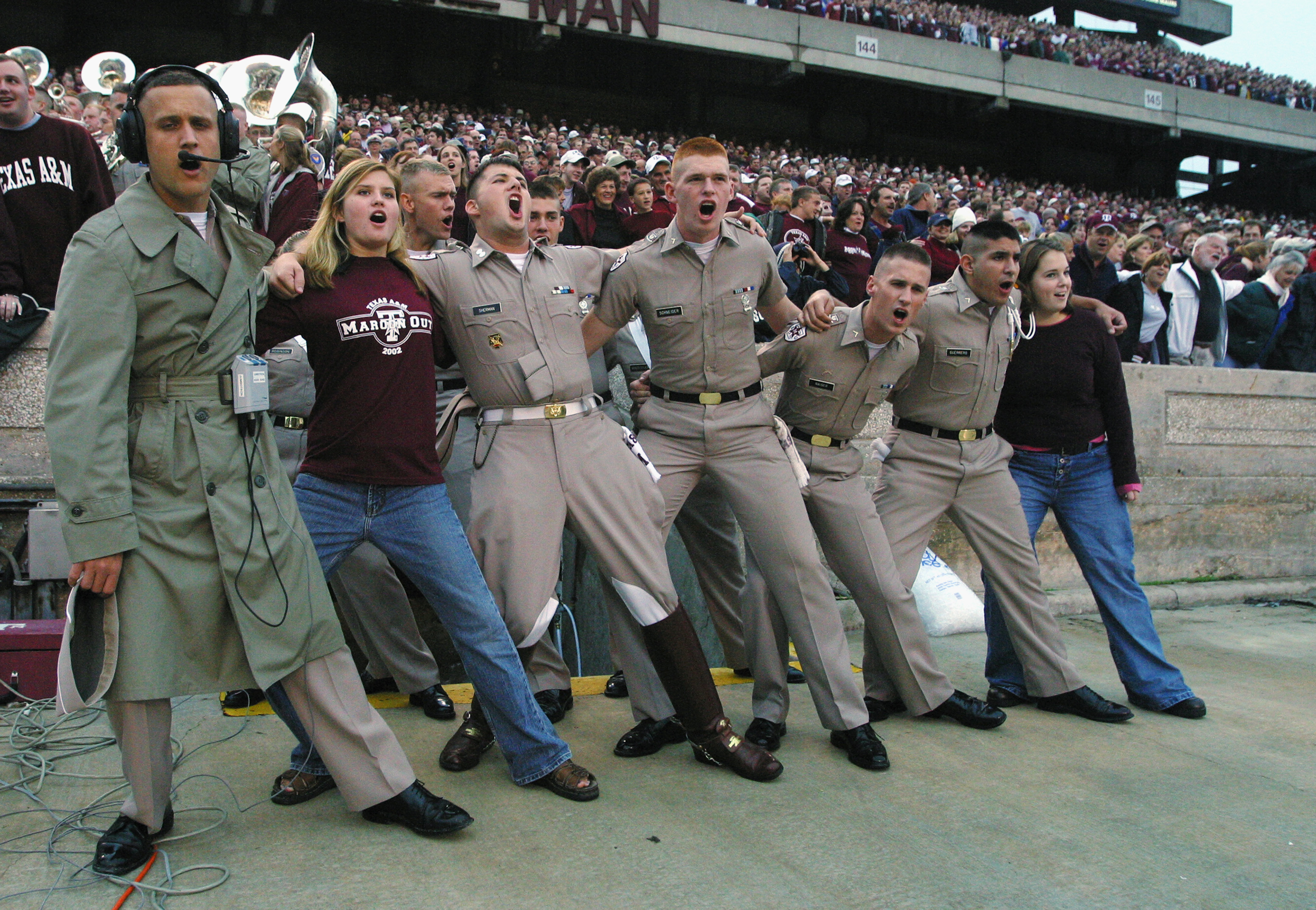 COLLEGE STATION, TX - OCTOBER 26:  Texas A&M Aggies cadets and their dates sing a school fight song and do a traditional arm in arm swaying in the game on October 26, 2002 versus the Nebraska Cornhuskers at Kyle Field at College Station, Texas. Nebraska w