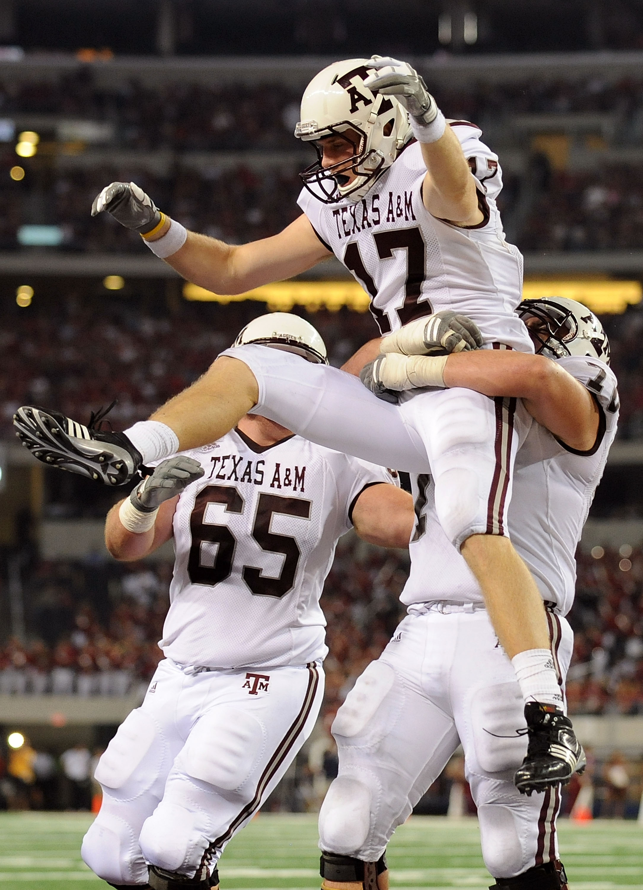 ARLINGTON, TX - OCTOBER 03:  Wide receiver Ryan Tannehill #17 celebrates a touchdown with Matt Allen #70 of the Texas A&M Aggies against the Arkansas Razorbacks at Cowboys Stadium on October 3, 2009 in Arlington, Texas.  (Photo by Ronald Martinez/Getty Im