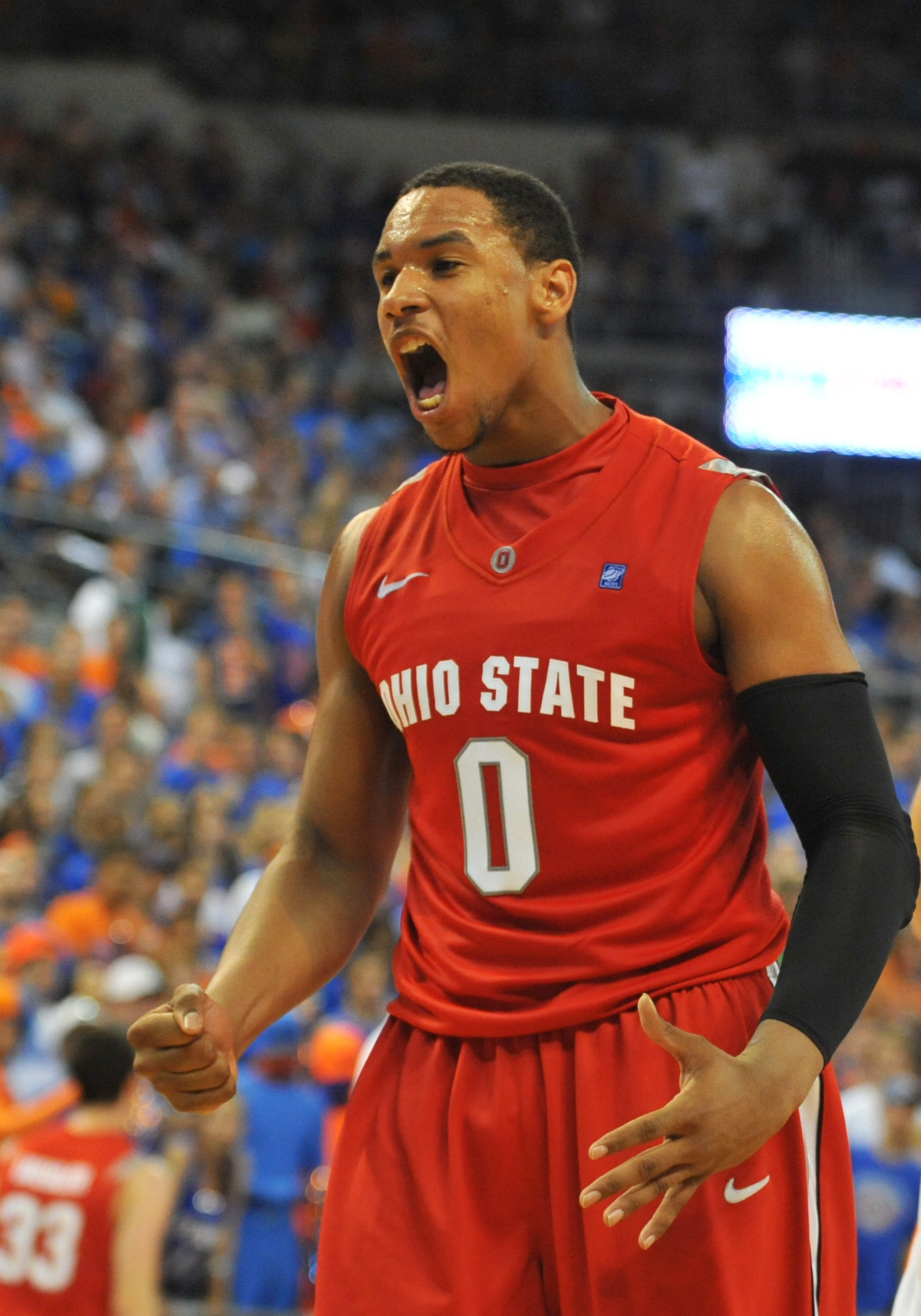 GAINESVILLE, FL - NOVEMBER 16: Forward Jared Sullinger #0 of the Ohio State Buckeyes yells after a dunk against the Florida Gators November 16, 2010 at the Stephen C. O'Connell Center in Gainesville, Florida.  (Photo by Al Messerschmidt/Getty Images)