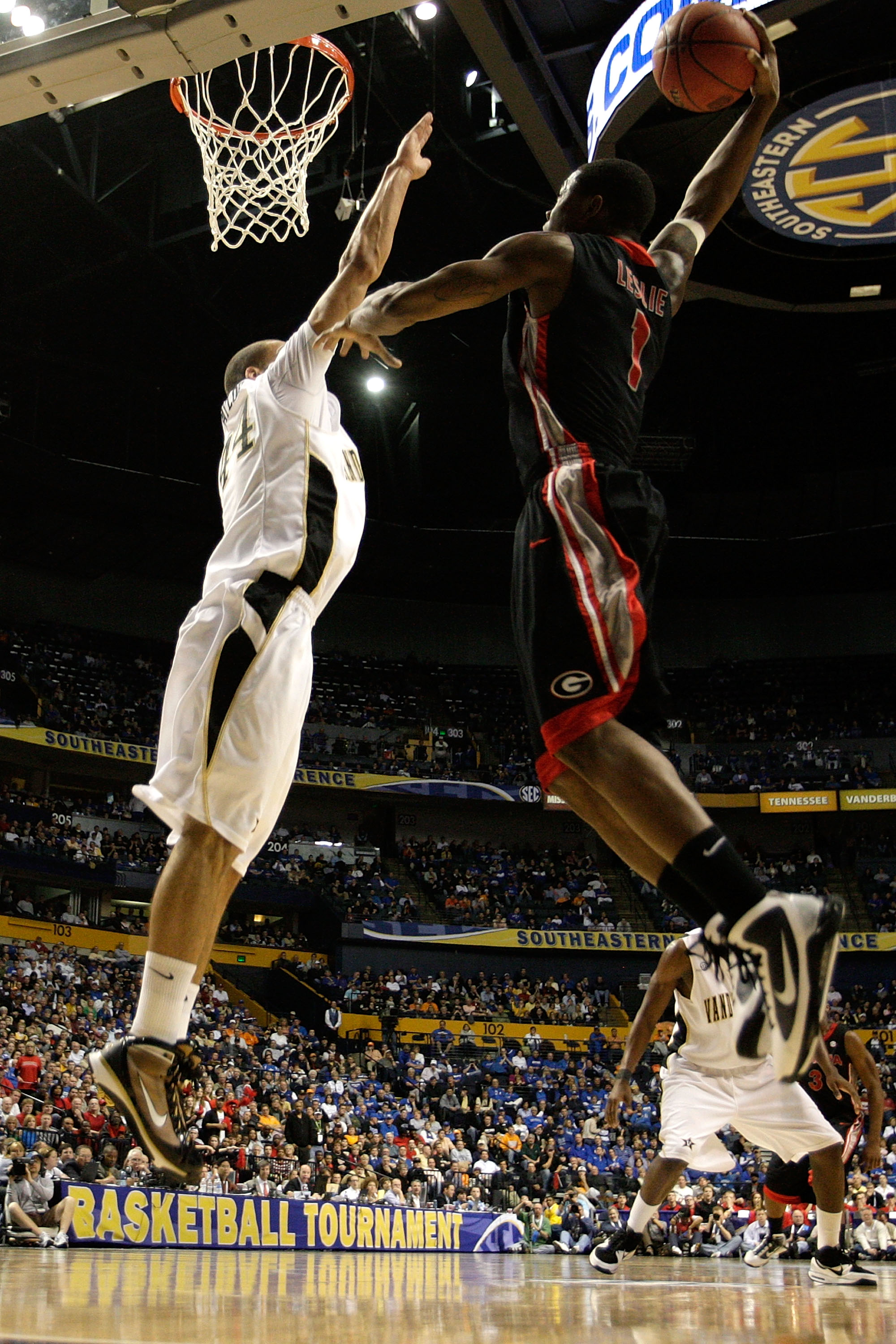 NASHVILLE, TN - MARCH 12:  Travis Leslie #1 of the the Georgia Bulldogs attempts a shot against Jeffery Taylor #44 of the Vanderbilt Commodores during the quarterfinals of the SEC Men's Basketball Tournament at the Bridgestone Arena on March 12, 2010 in N