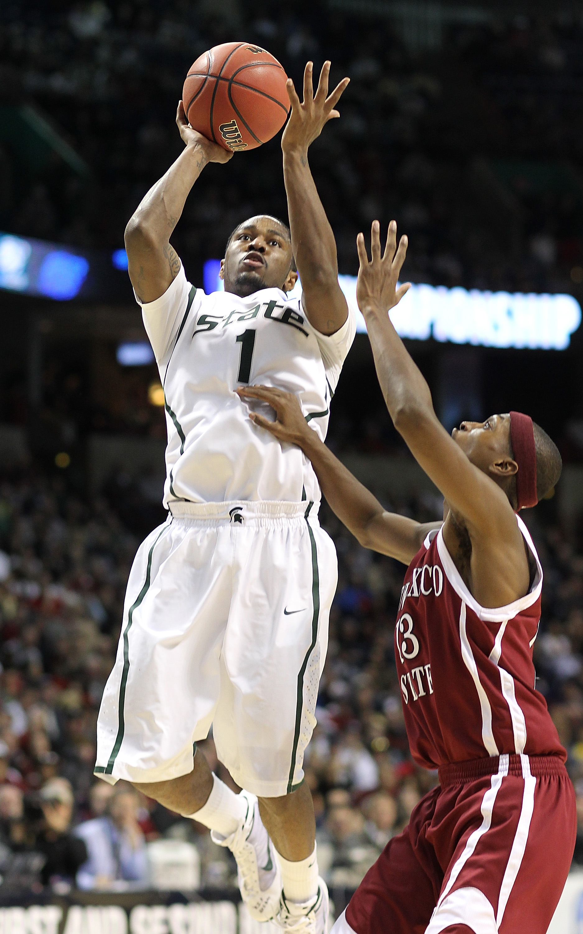 SPOKANE - MARCH 19:  Kalin Lucas #1 of the Michigan State Spartans shoots against Hernst Laroche #13 of the New Mexico State Aggies during the first round of the 2010 NCAA men's basketball tournament at the Spokane Arena on March 19, 2010 in Spokane, Wash