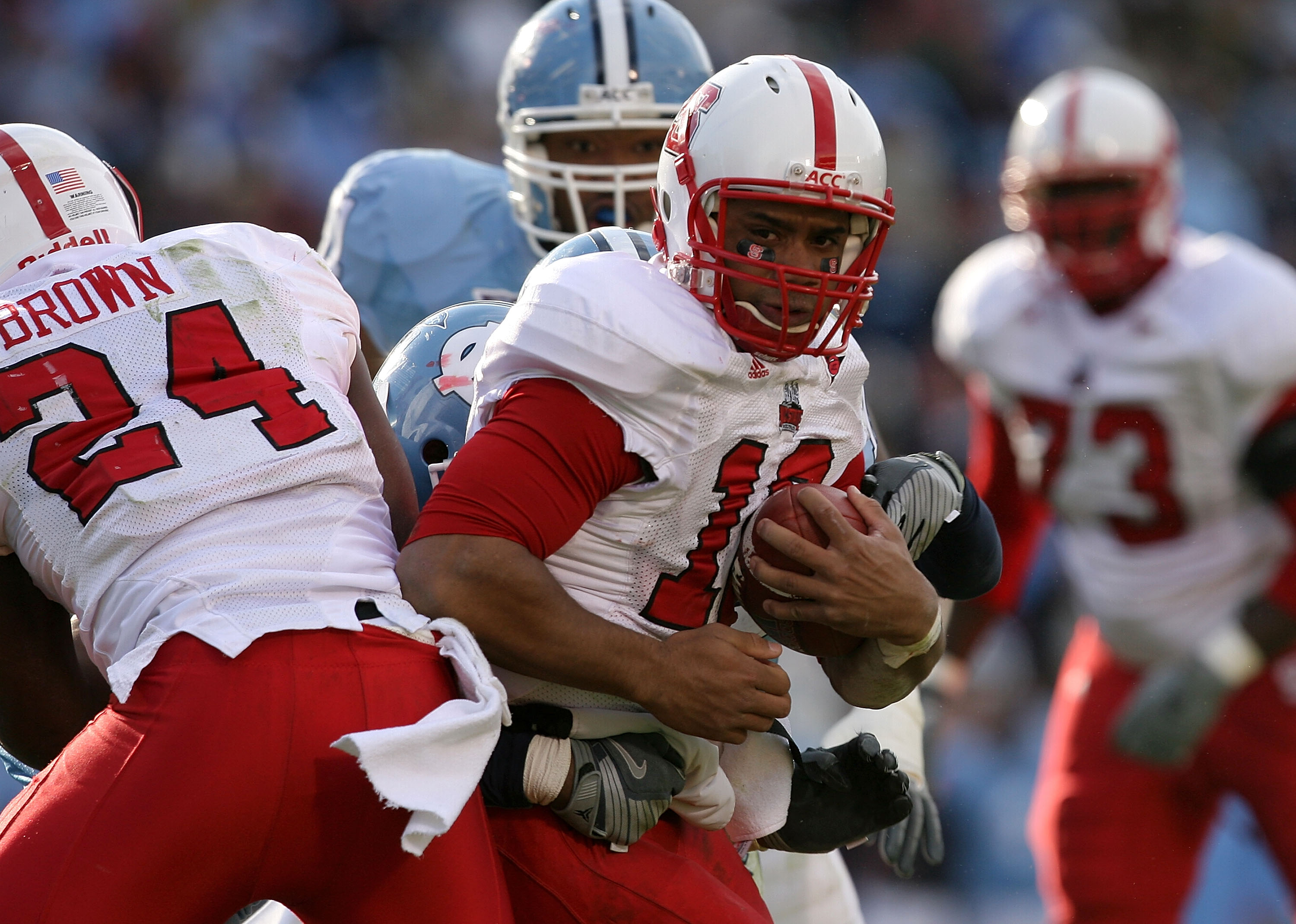 CHAPEL HILL, NC - NOVEMBER 22:  Russell Wilson #16 of the North Carolina State Wolfpack runs with the ball against the North Carolina Tar Heels at Kenan Stadium on November 22, 2008 in Chapel Hill, North Carolina.  (Photo by Streeter Lecka/Getty Images)