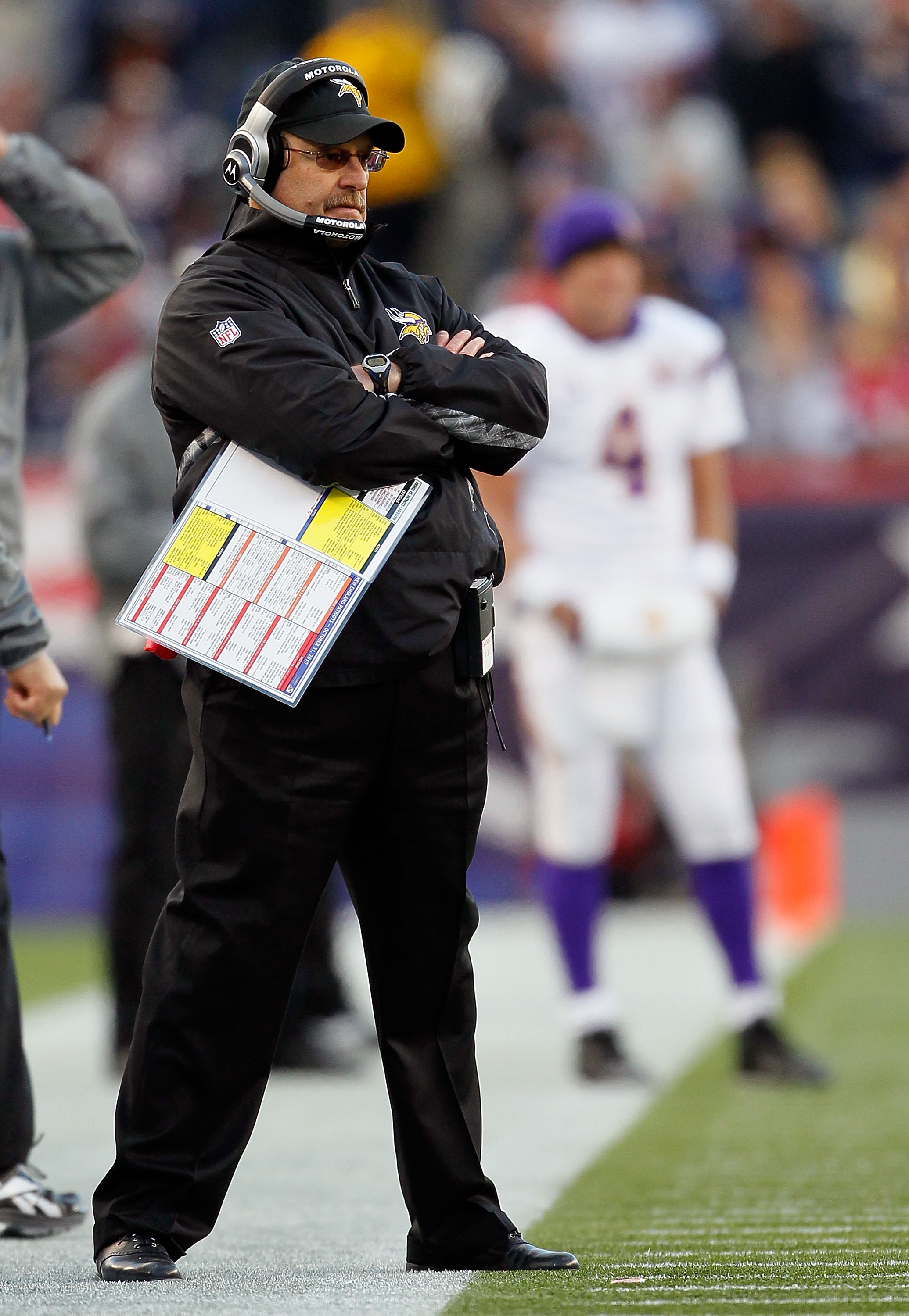 FOXBORO, MA - OCTOBER 31:  Coach Brad Childress and Brett Favre #4 of the Minnesota Vikings (rear) watch the action against the New England Patriots at Gillette Stadium on October 31, 2010 in Foxboro, Massachusetts. (Photo by Jim Rogash/Getty Images)