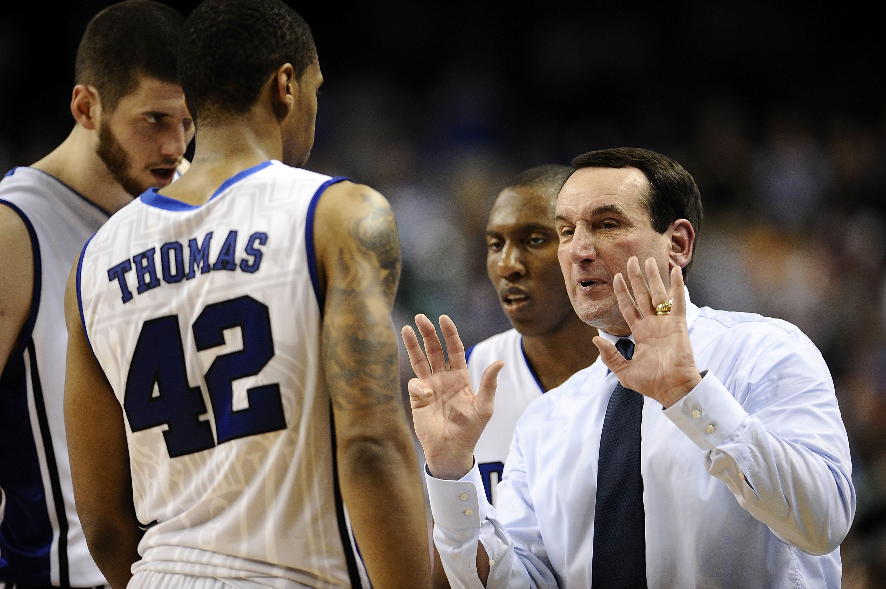 GREENSBORO, NC - MARCH 13:  Mike Krzyzewski, head coach of the Duke Blue Devils talks to his team against the University of Miami Hurricanes in their semifinal game in the 2010 ACC Men's Basketball Tournament at the Greensboro Coliseum on on March 13, 201