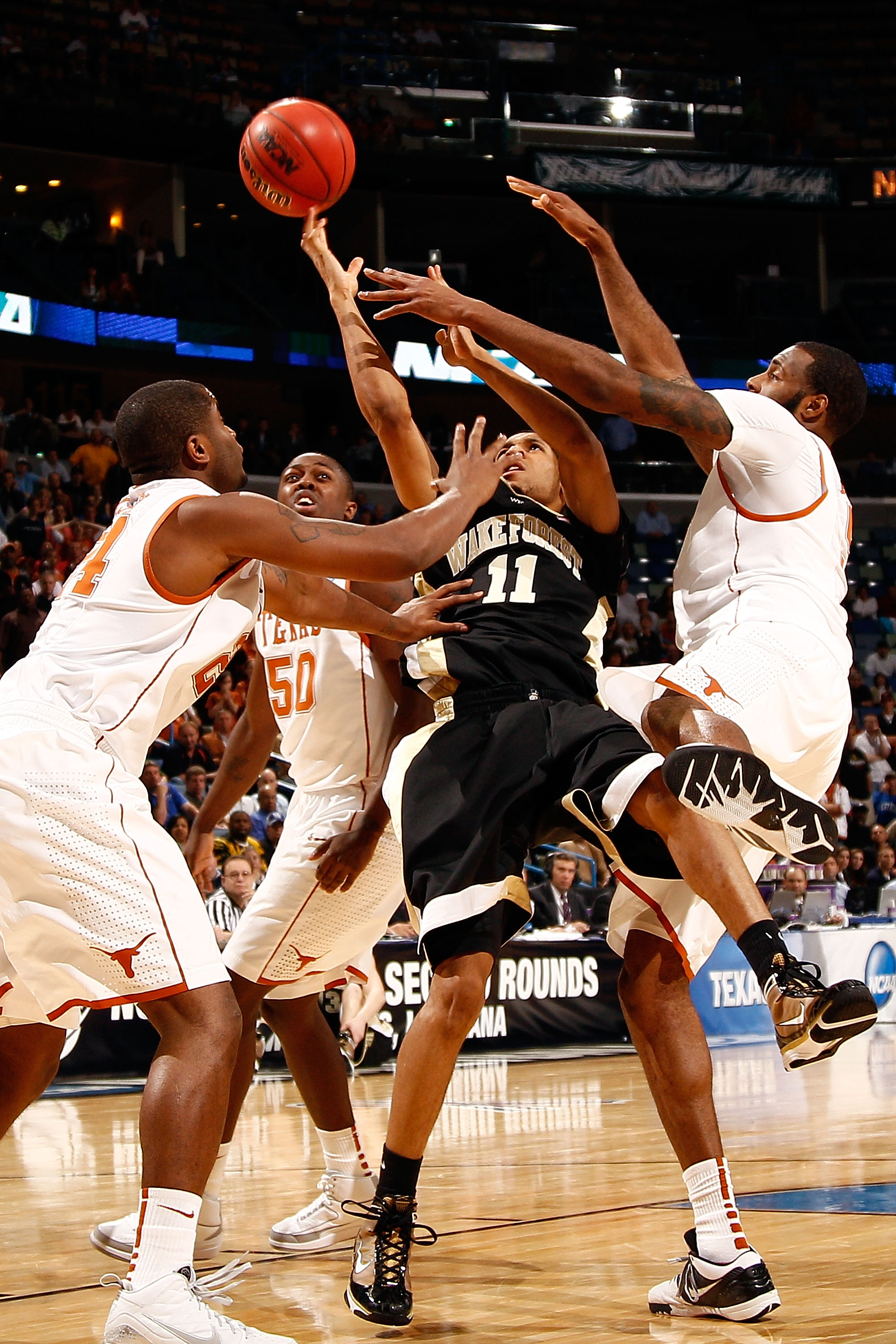 NEW ORLEANS - MARCH 18:  C.J. Harris #11 of the Wake Forest Demon Deacons shoots the ball Justin Mason #24 of the Texas Longhorns during the first round of the 2010 NCAA men�s basketball tournament at the New Orleans Arena on March 18, 2010 in New Orleans