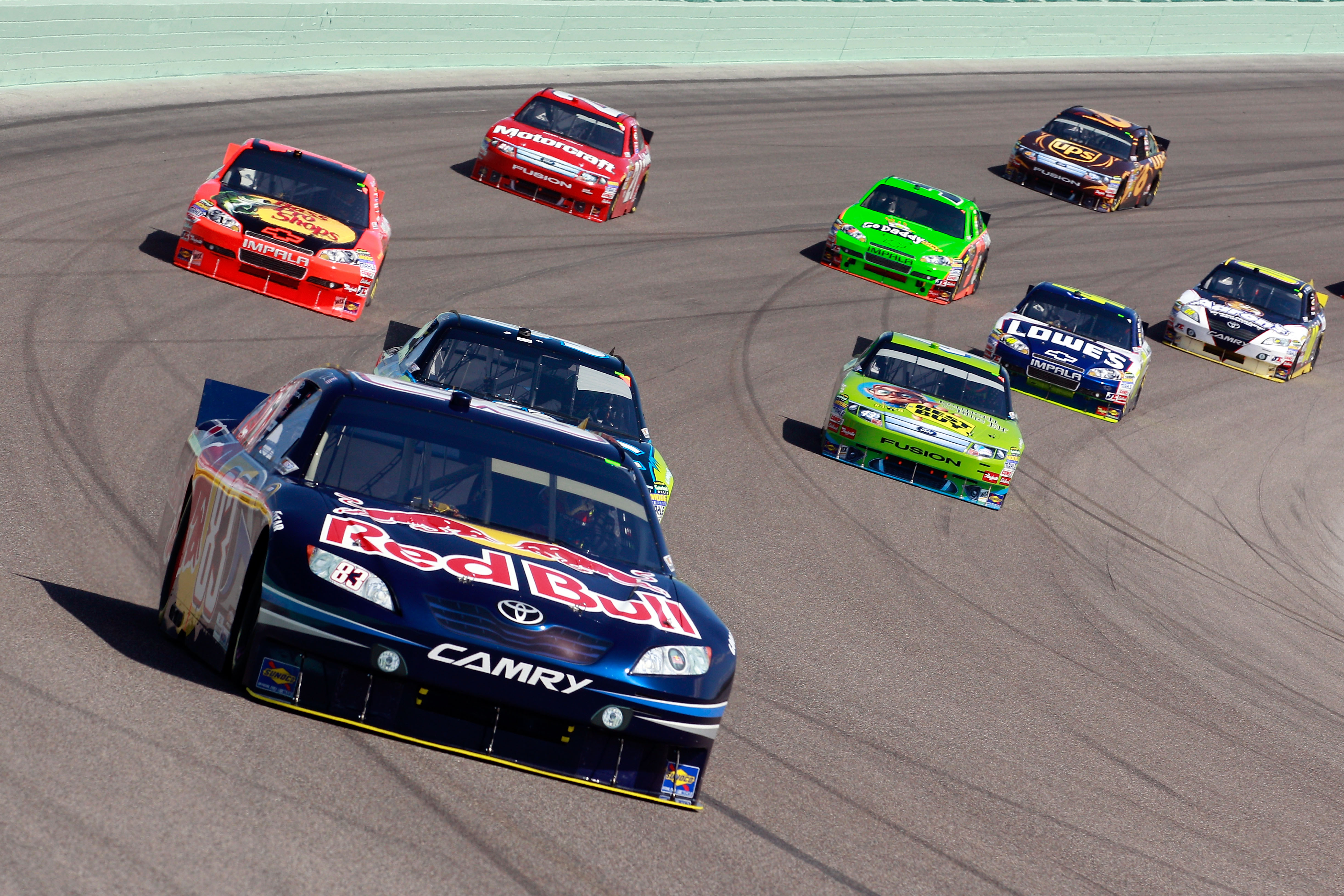 HOMESTEAD, FL - NOVEMBER 21:  Kasey Kahne, driver of the #83 Red Bull Toyota, leads a group of cars during the NASCAR Sprint Cup Series Ford 400 at Homestead-Miami Speedway on November 21, 2010 in Homestead, Florida.  (Photo by Sam Greenwood/Getty Images)