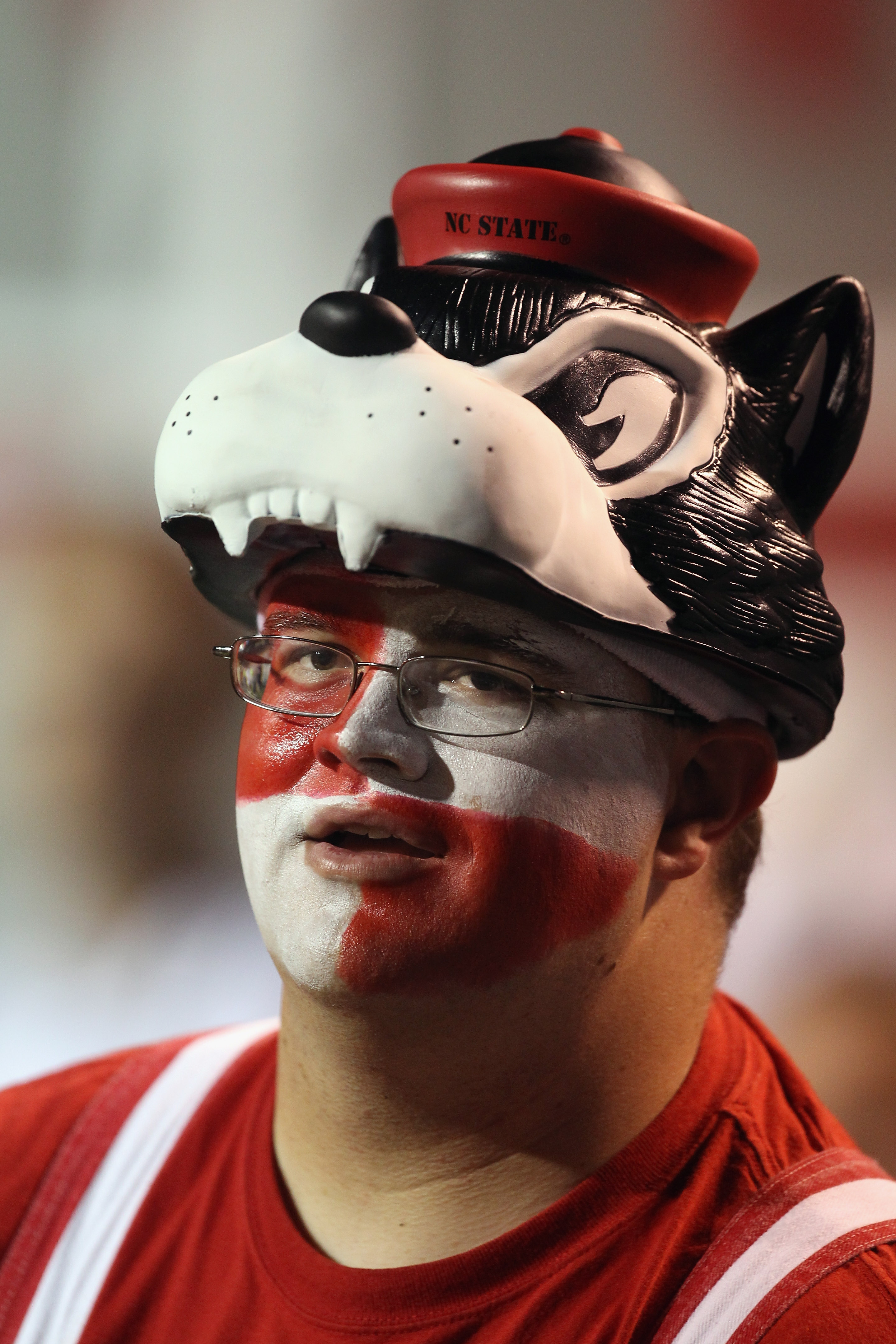 RALEIGH, NC - OCTOBER 28:  A fan of the North Carolina State Wolfpack watches on against the Florida State Seminoles during their game at Carter-Finley Stadium on October 28, 2010 in Raleigh, North Carolina.  (Photo by Streeter Lecka/Getty Images)