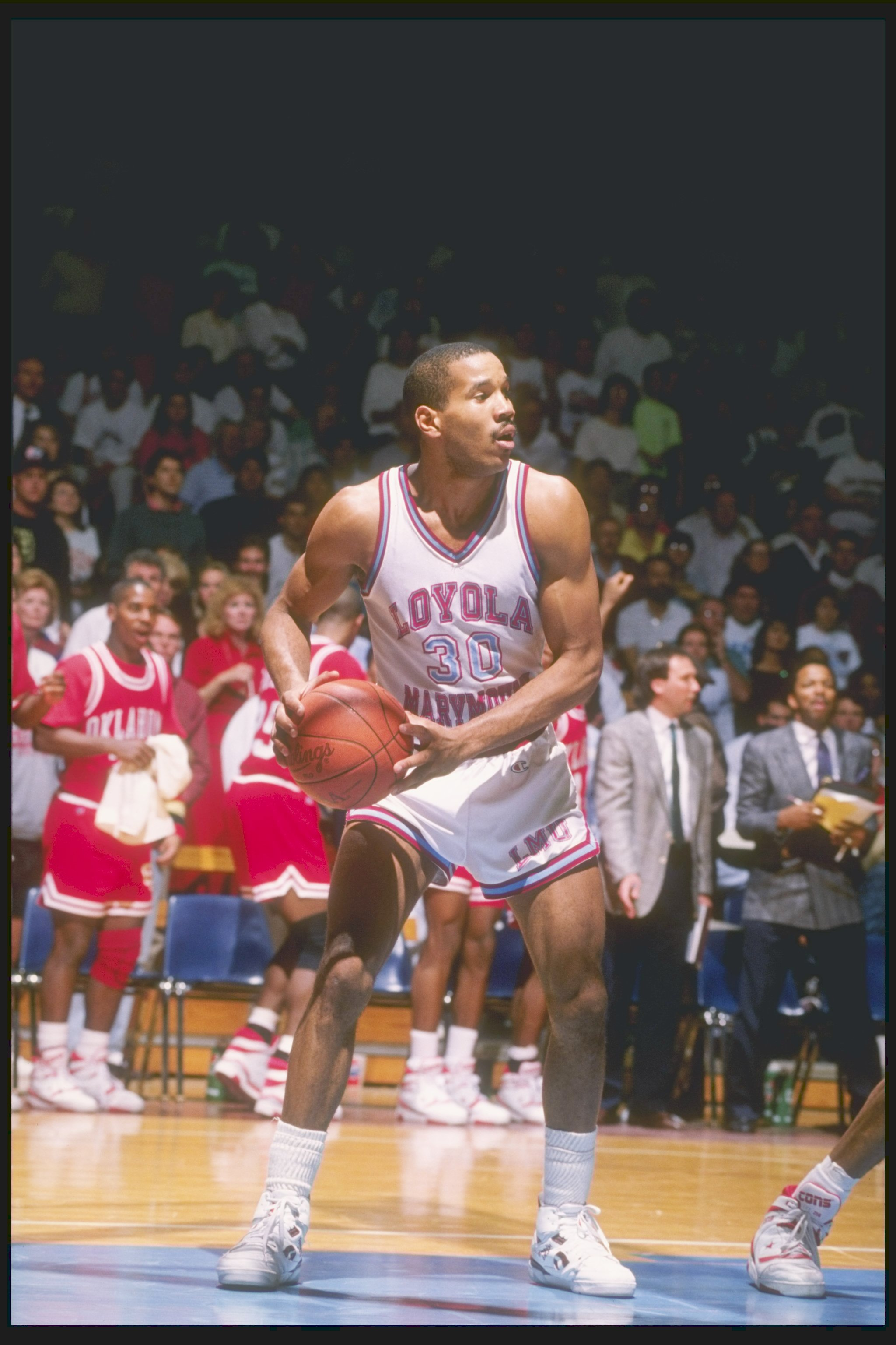 1990:  Guard Bo Kimble of the Loyola-Marymount Lions holds the ball during a game. Mandatory Credit: Mike Powell  /Allsport
