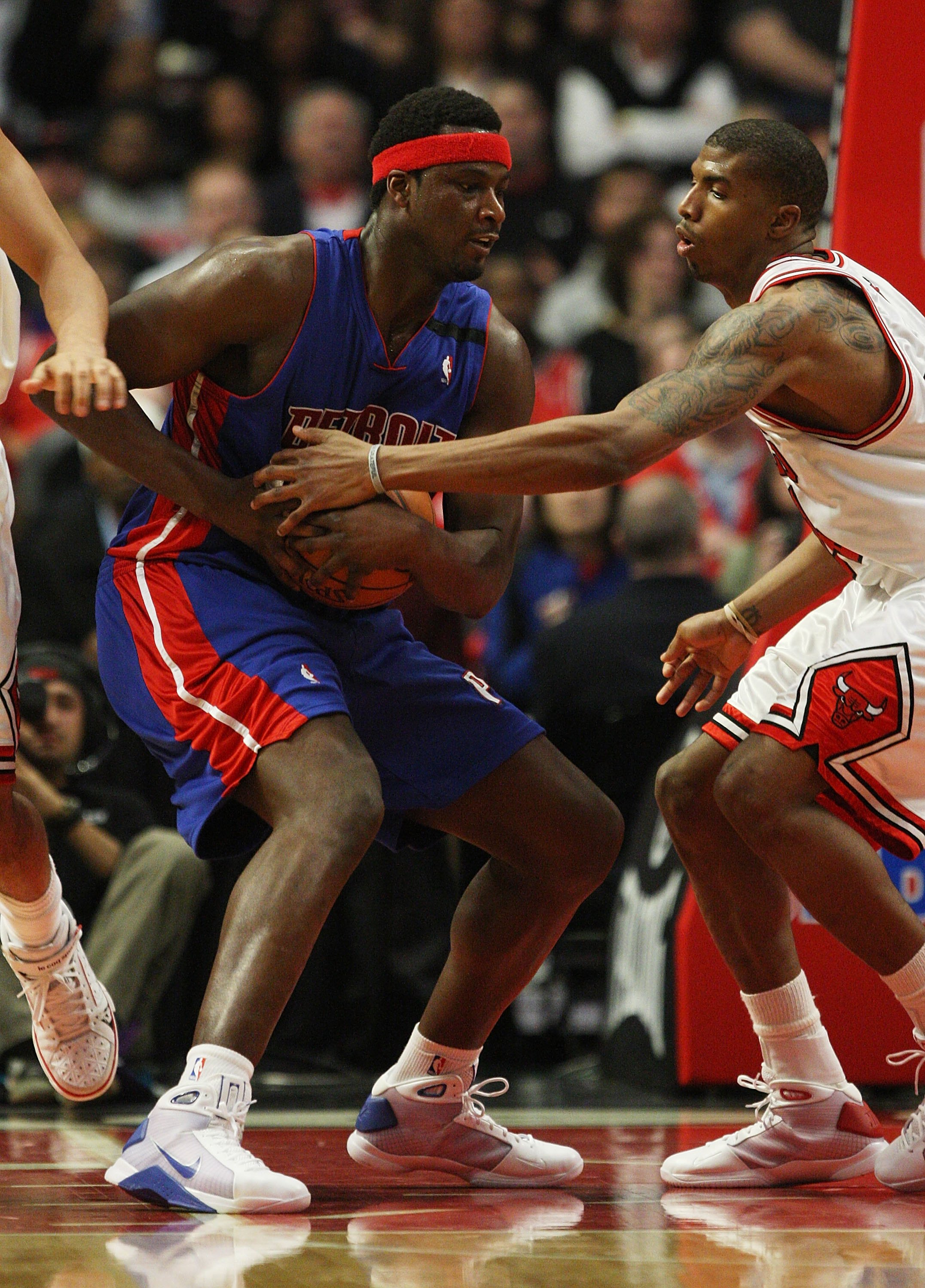 CHICAGO - MARCH 24: Tyrus Thomas #24 of the Chicago Bulls tries to steal the ball away from Kwame Brown #38 of the Detroit Pistons on March 24, 2009 at the United Center in Chicago, Illinois. The Bulls defeated the Pistons 99-91. NOTE TO USER: User expres
