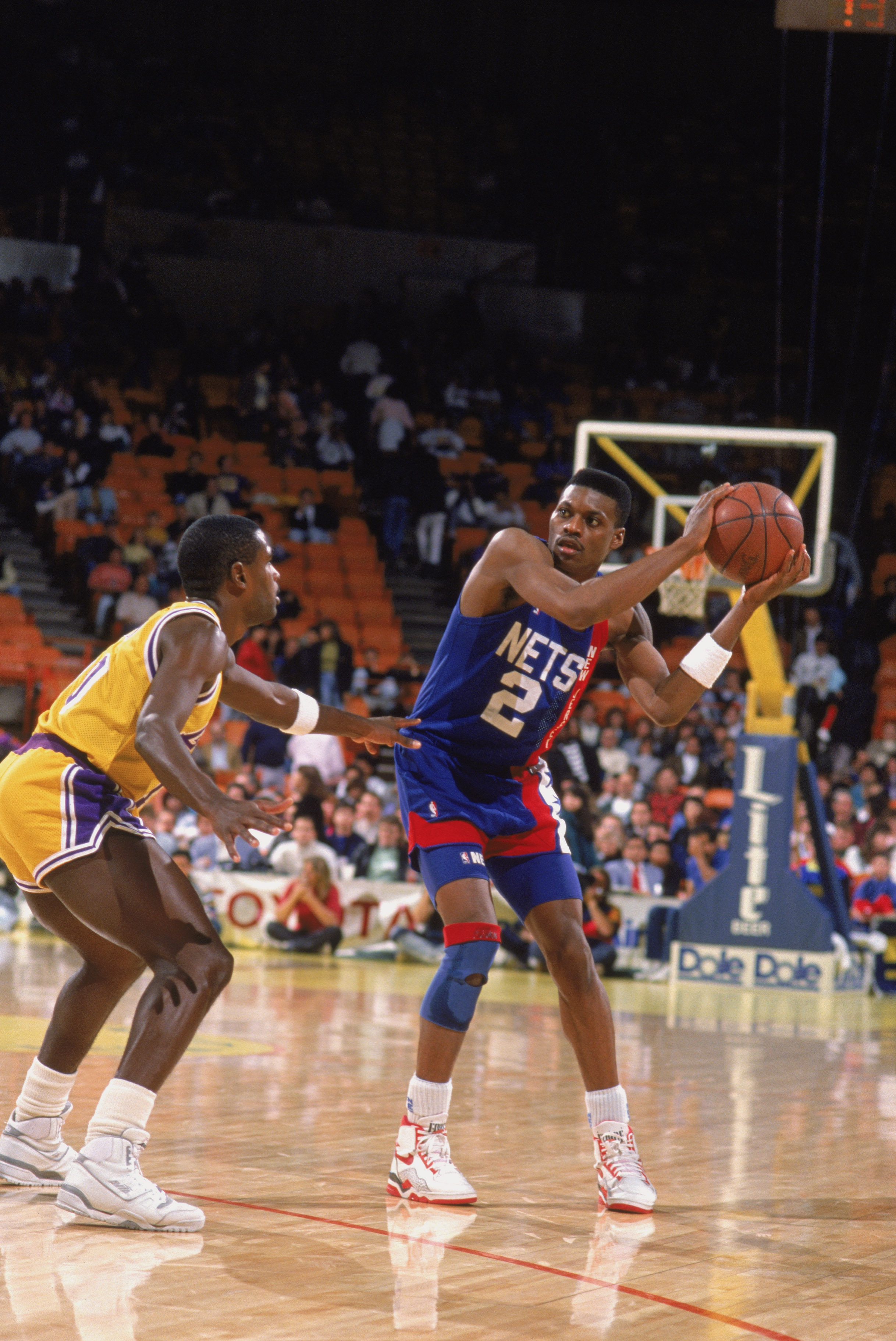 LOS ANGELES - 1990:  Dennis Hopson #2 of the New Jersey Nets holds the ball at the perimeter against defender Larry Drew #10 of the Los Angeles Lakers during the NBA game at the Great Western Forum in Los Angeles, California in 1990. NOTE TO USER: User ex