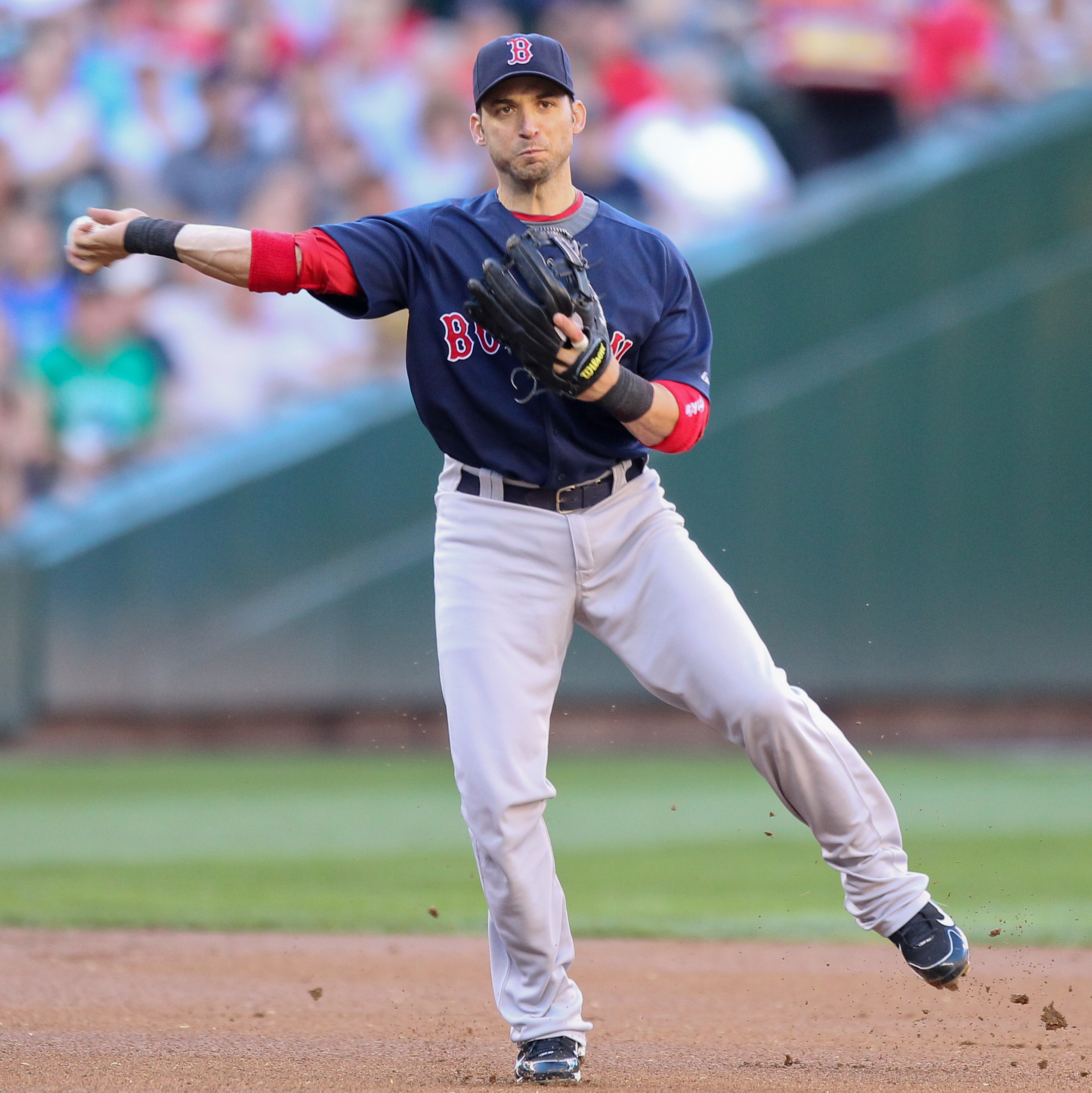 SEATTLE - JULY 24:  Shortstop Marco Scutaro #16 of the Boston Red Sox throws to first against the Seattle Mariners at Safeco Field on July 24, 2010 in Seattle, Washington. (Photo by Otto Greule Jr/Getty Images)