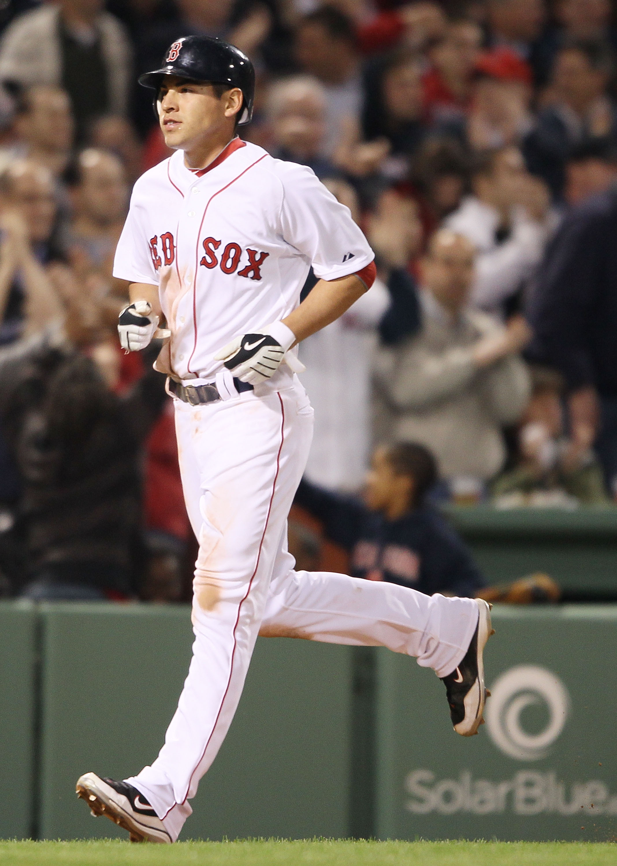 BOSTON - APRIL 06:  Jacoby Ellsbury #2 of the Boston Red Sox heads for home after teammate Victor Martinez hit a two run homer in the third inning against the New York Yankees on April 6, 2010 at Fenway Park in Boston, Massachusetts.  (Photo by Elsa/Getty