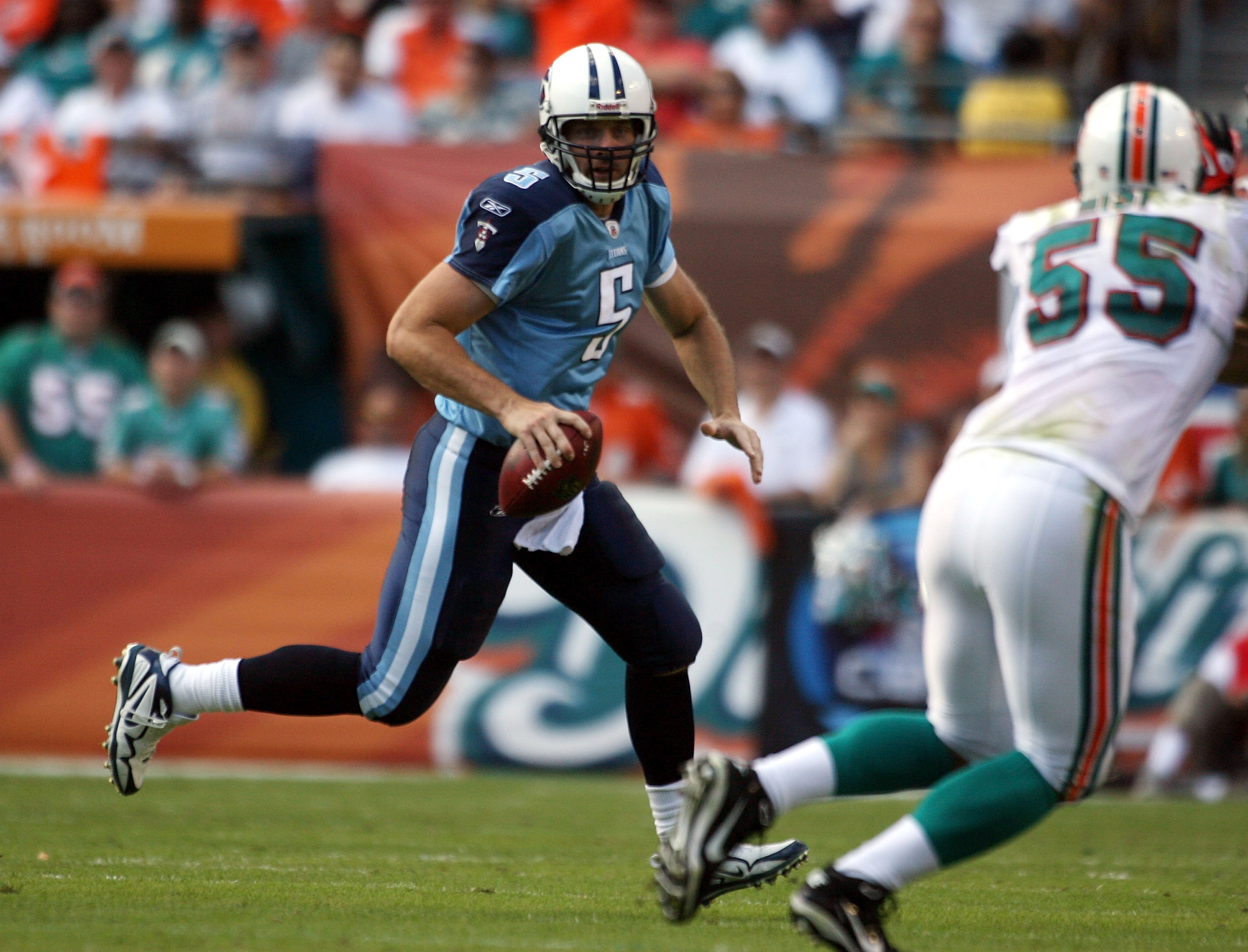 MIAMI - NOVEMBER 14:  Quarterback Kerry Collins #5 of the Tennessee Titans runs against the Miami Dolphins at Sun Life Stadium on November 14, 2010 in Miami, Florida.  (Photo by Marc Serota/Getty Images)