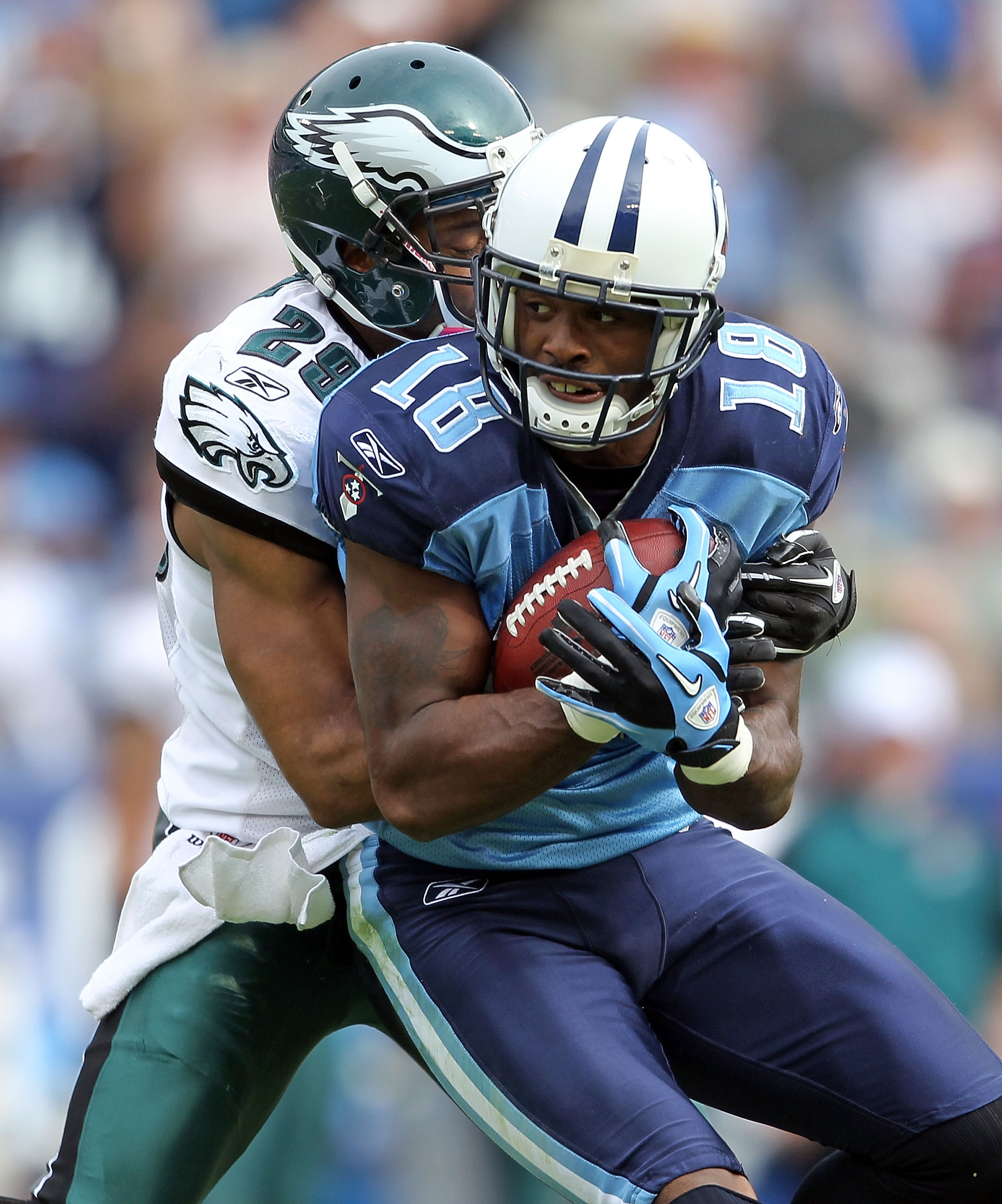 NASHVILLE, TN - OCTOBER 24:  Kenny Britt #18 of the Tennessee Titans catches a pass while defended by Nate Allen #29 of the Philadelphia Eagles during the NFL game at LP Field on October 24, 2010 in Nashville, Tennessee. The Titans won 37-19.  (Photo by A