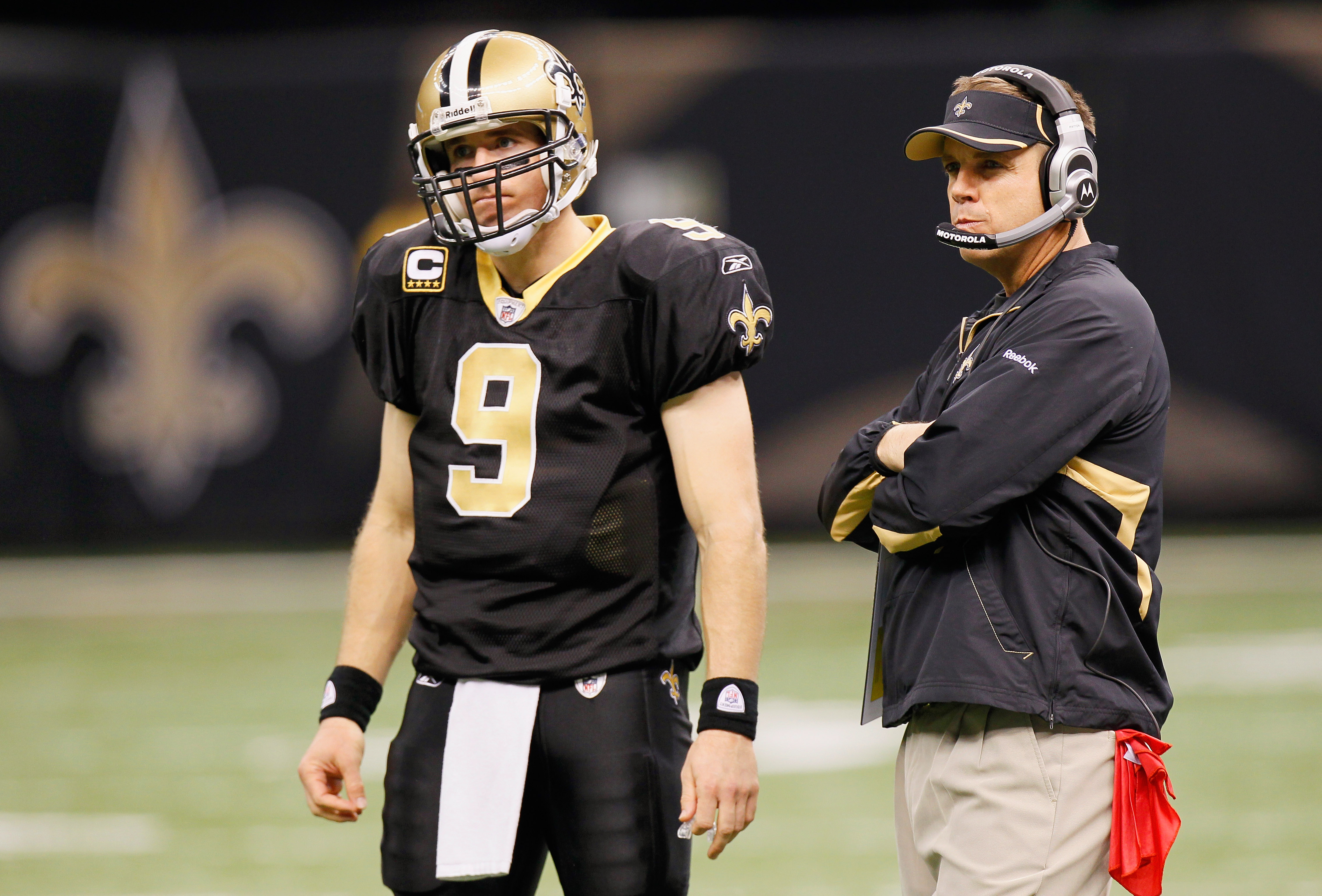 NEW ORLEANS - NOVEMBER 21:  Quarterback Drew Brees #9 and head coach Sean Payton of the New Orleans Saints wait for the call from a review against the Seattle Seahawks at Louisiana Superdome on November 21, 2010 in New Orleans, Louisiana.  (Photo by Kevin