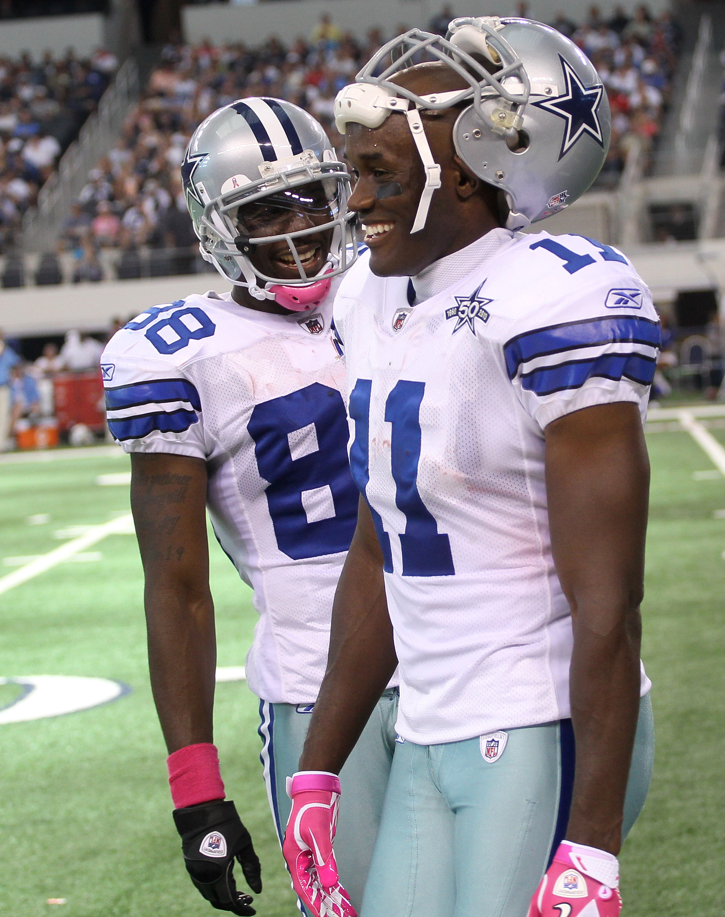 ARLINGTON, TX - OCTOBER 10:  Wide receivers Roy Williams #11 and Dez Bryant #88 of the Dallas Cowboys laugh during the game against the Tennessee Titans at Cowboys Stadium on October 10, 2010 in Arlington, Texas. The Titans won 34-27.  (Photo by Stephen D