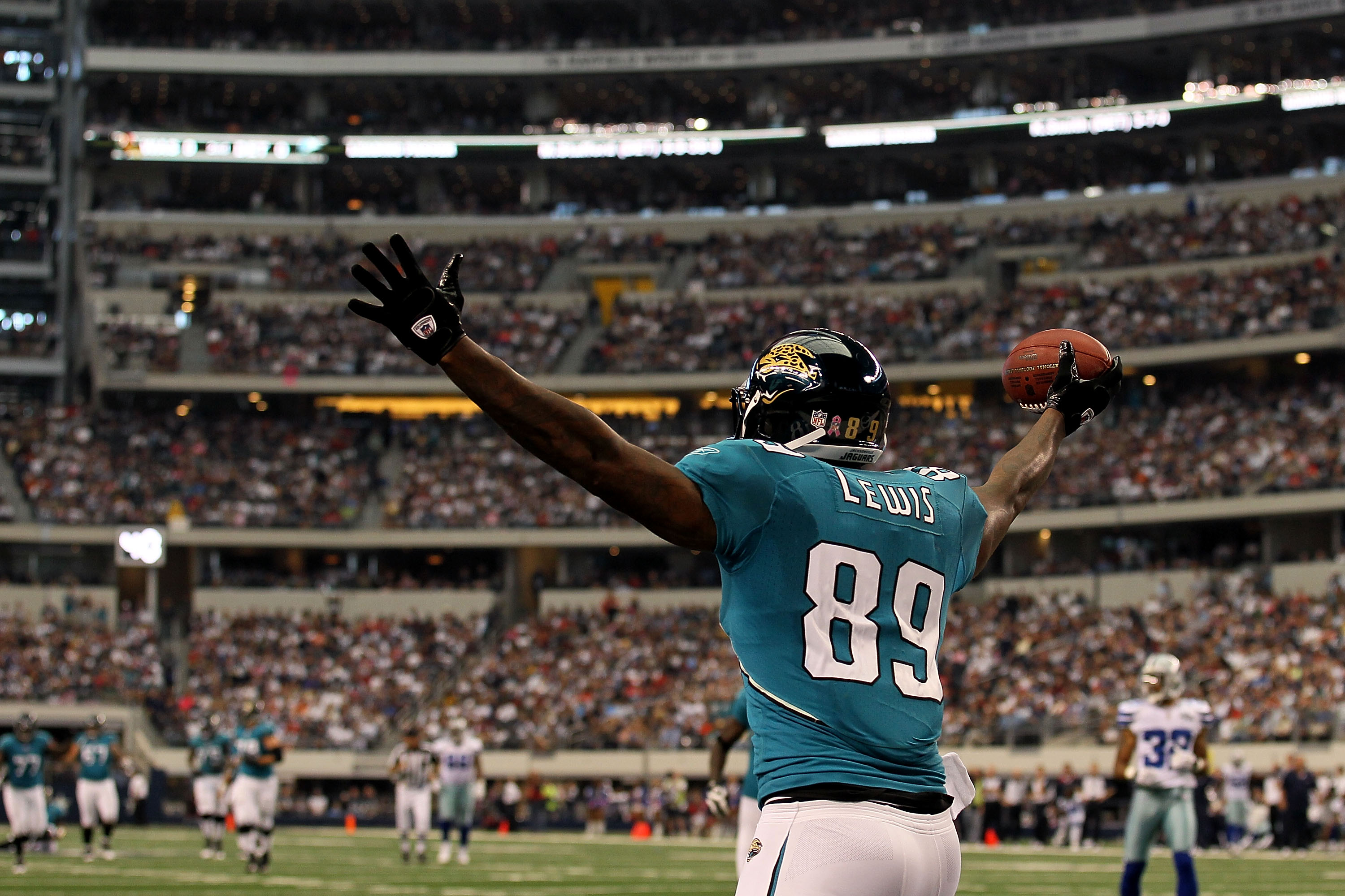 ARLINGTON, TX - OCTOBER 31:  Marcedes Lewis #89 of the Jacksonville Jaguars celebrates after he scored a touchdown against the Dallas Cowboys at Cowboys Stadium on October 31, 2010 in Arlington, Texas.  (Photo by Stephen Dunn/Getty Images)