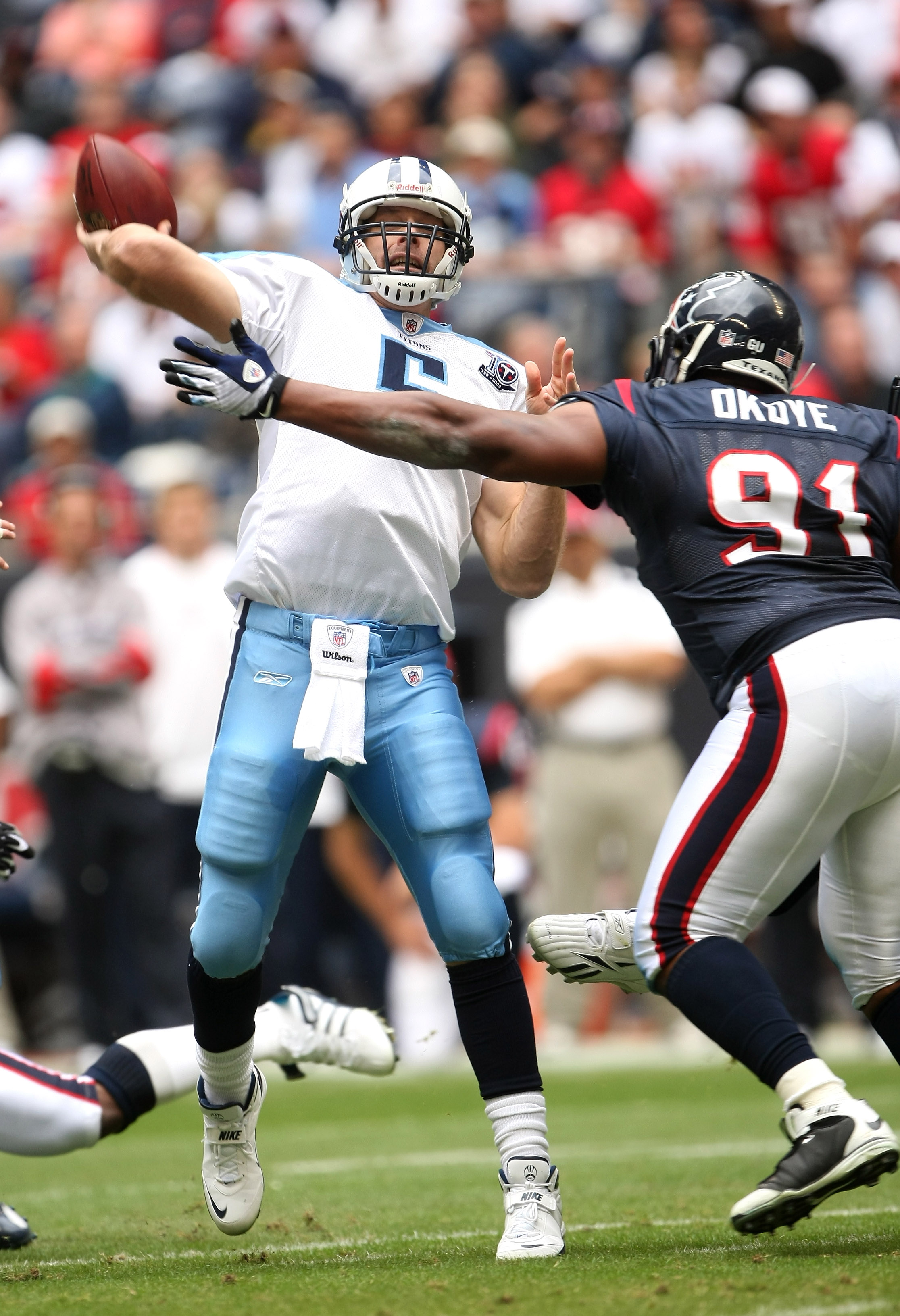 HOUSTON - DECEMBER 14:  Quarterback Kerry Collins #5 of the Tennessee Titans throws a pass over defensive tackle Amobi Okoye #91 of the Houston Texans on December 14, 2008 at Reliant Stadium in Houston, Texas.  (Photo by Stephen Dunn/Getty Images)