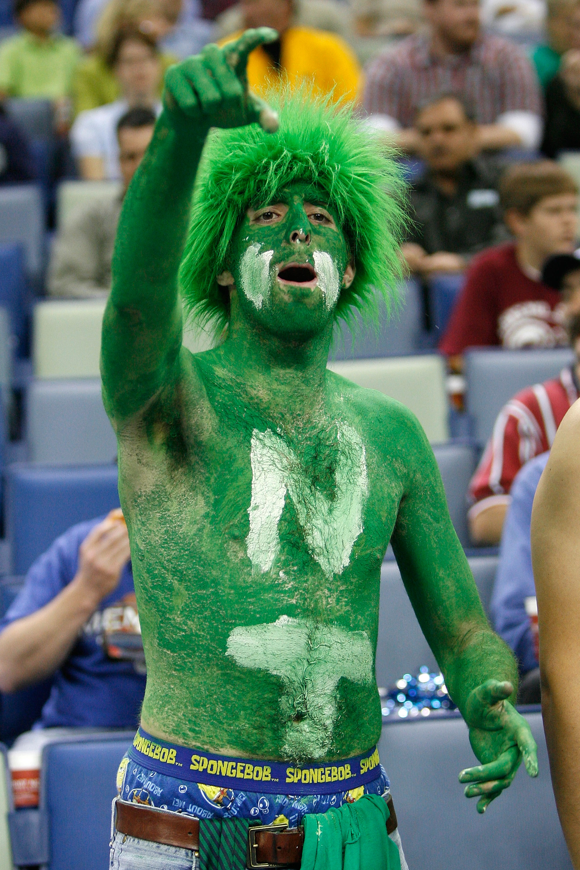 NEW ORLEANS - MARCH 16:  A fan of the North Texas Mean Green cheers for the team over the Memphis Tigers during round one of the NCAA Men's Basketball Tournament at the New Orleans Arena on March 16, 2007 in New Orleans, Louisiana.  (Photo by Chris Grayth