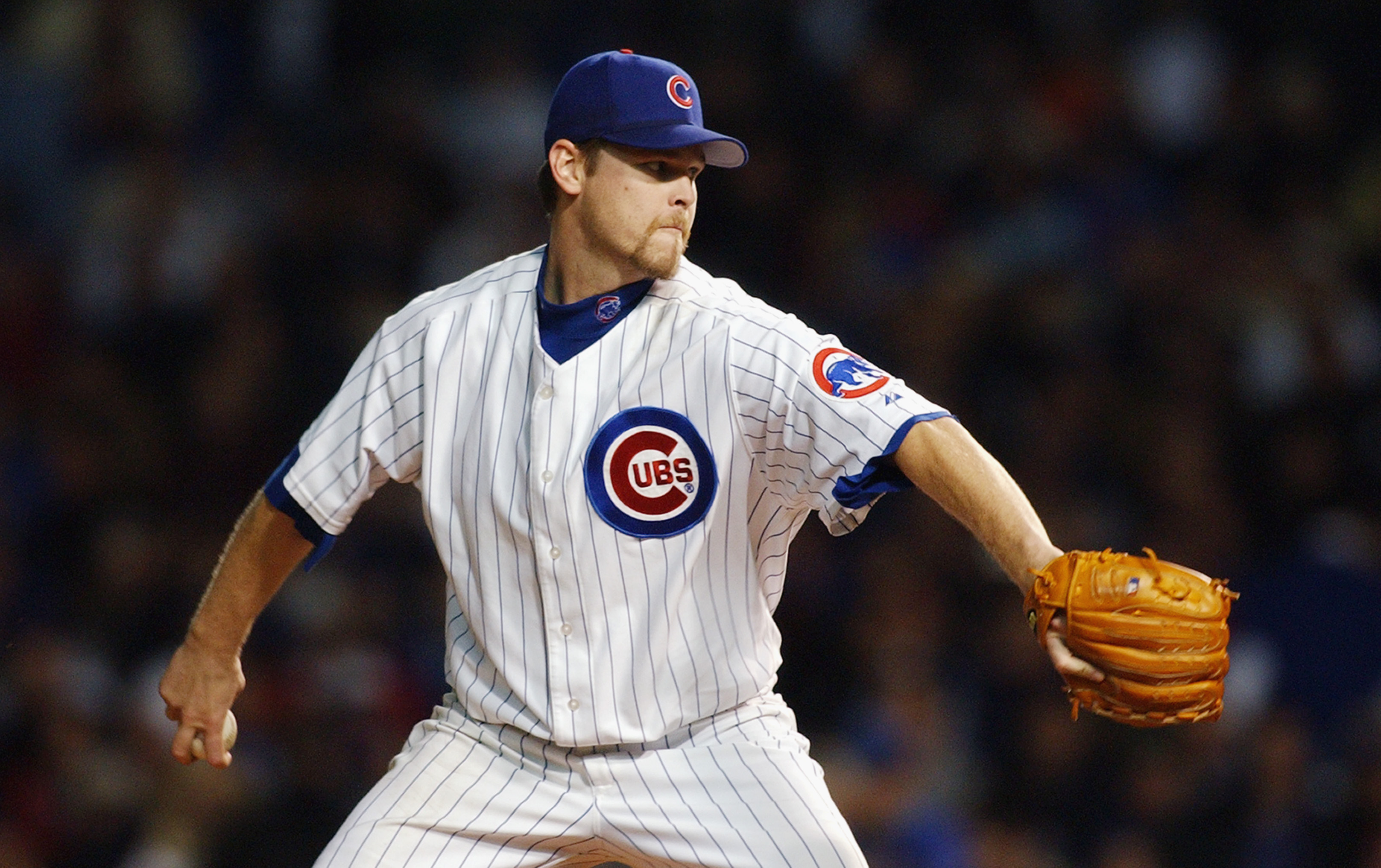 CHICAGO - OCTOBER 15:  Starting pitcher Kerry Wood #34 of the Chicago Cubs throws against the Florida Marlins during game seven of the National League Championship Series on October 15, 2003 at Wrigley Field in Chicago, Illinois.  The Marlins defeated the