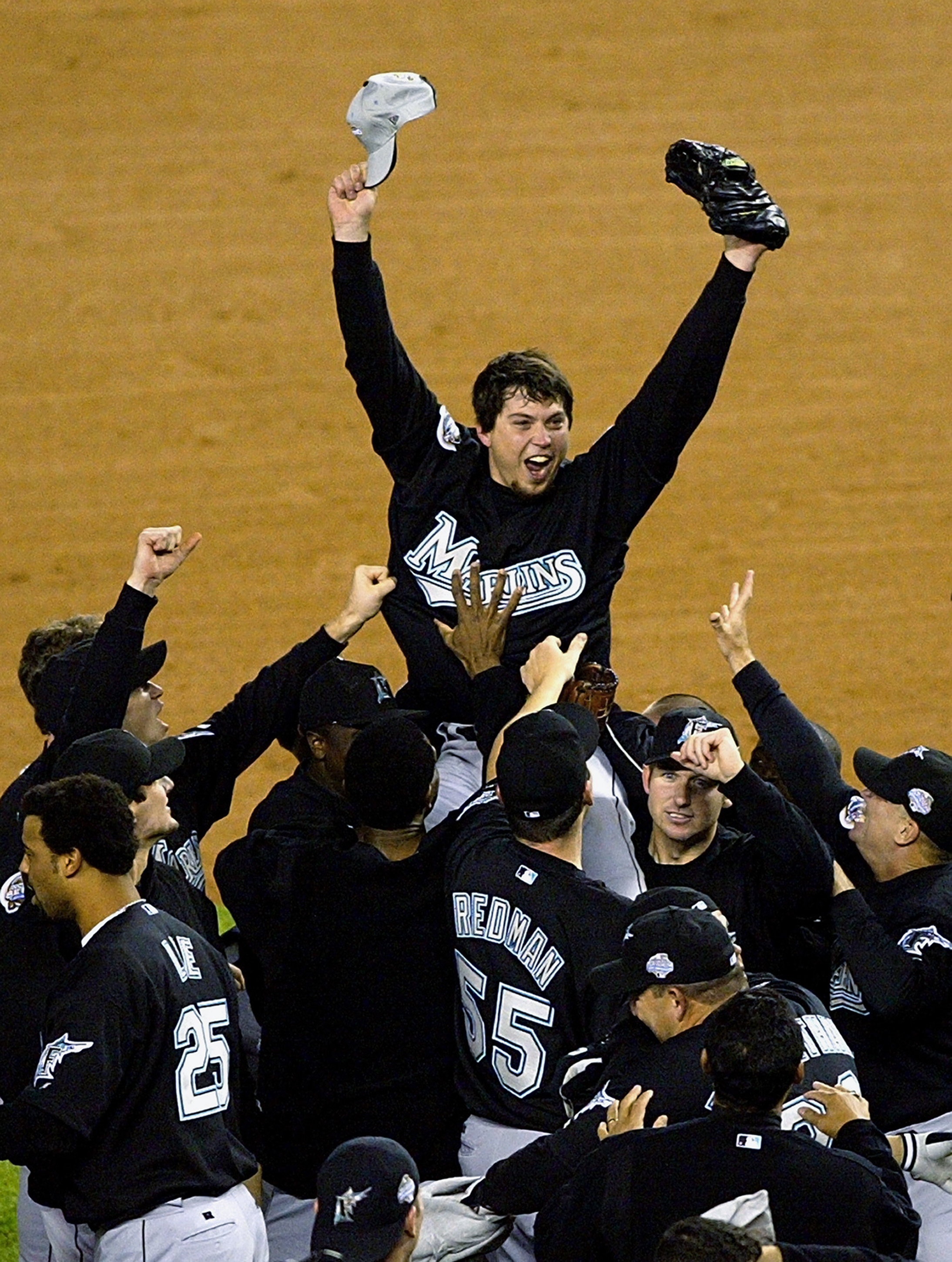 RONX, NY - OCTOBER 25:  The Florida Marlins hoist up pitcher Josh Beckett #21 the 2003 World Series MVP after defeating the New York Yankees 2-0 in game six of the Major League Baseball World Series on October 25, 2003 at Yankee Stadium in the Bronx, New