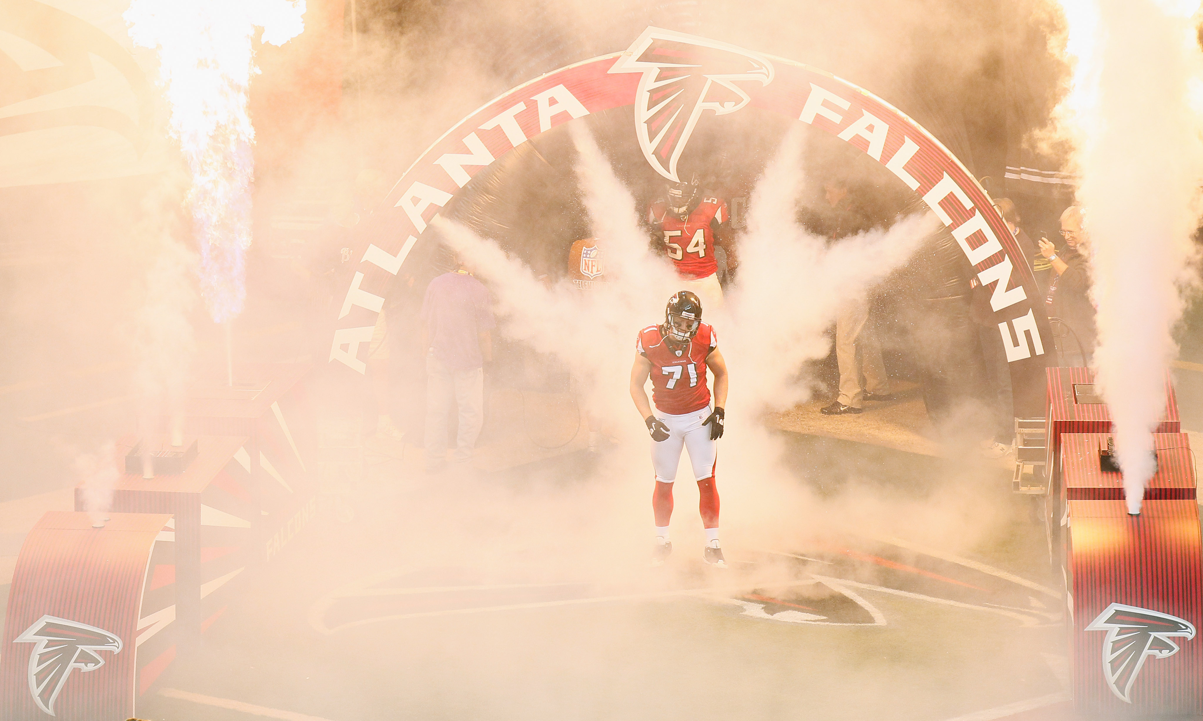 ATLANTA - NOVEMBER 07:  Kroy Biermann #71 of the Atlanta Falcons walks out of the tunnel during defensive player introductions before facing the Tampa Bay Buccaneers at Georgia Dome on November 7, 2010 in Atlanta, Georgia.  (Photo by Kevin C. Cox/Getty Im