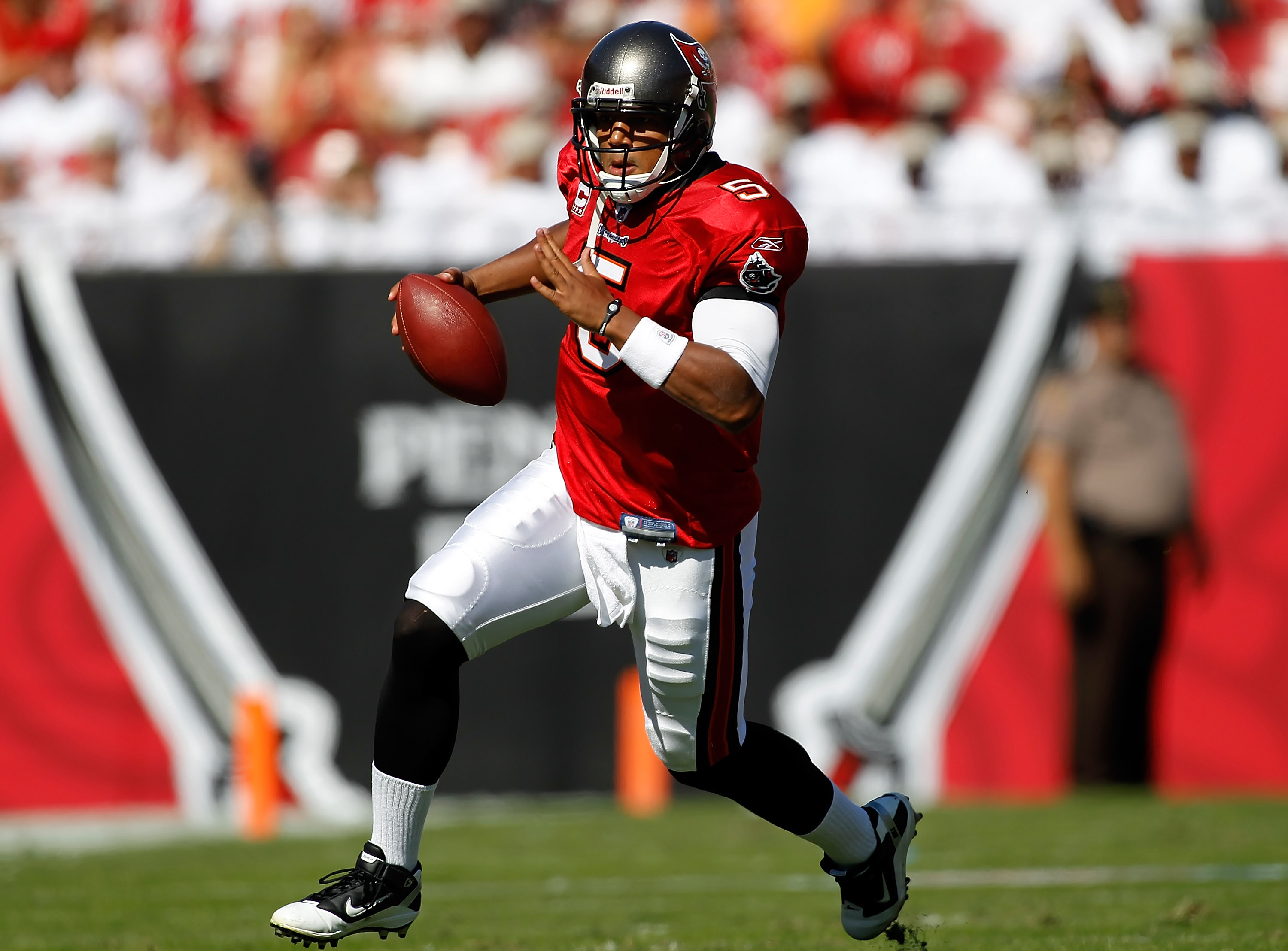 TAMPA, FL - NOVEMBER 14:  Quarterback Josh Freeman #5 of the Tampa Bay Buccaneers scrambles against the Carolina Panthers during the game at Raymond James Stadium on November 14, 2010 in Tampa, Florida.  (Photo by J. Meric/Getty Images)