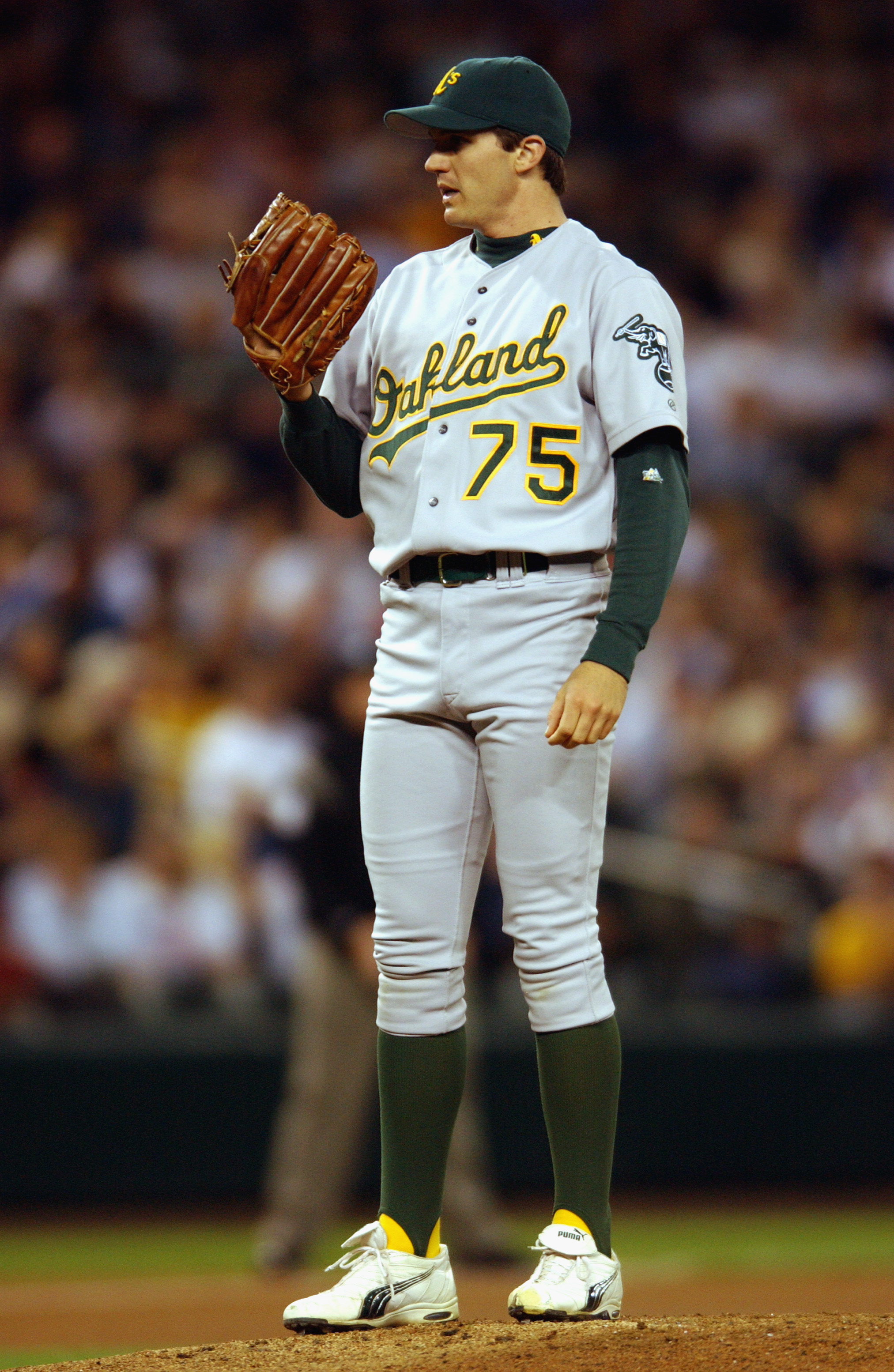 SEATTLE - SEPTEMBER 24:  Pitcher Barry Zito #75 of the Oakland Athletics looks in for the sign during the MLB game against the Seattle Mariners on September 24, 2002 at Safeco Field in Seattle, Washington. The Mariners won 8-7. (Photo by Otto Greule Jr/Ge