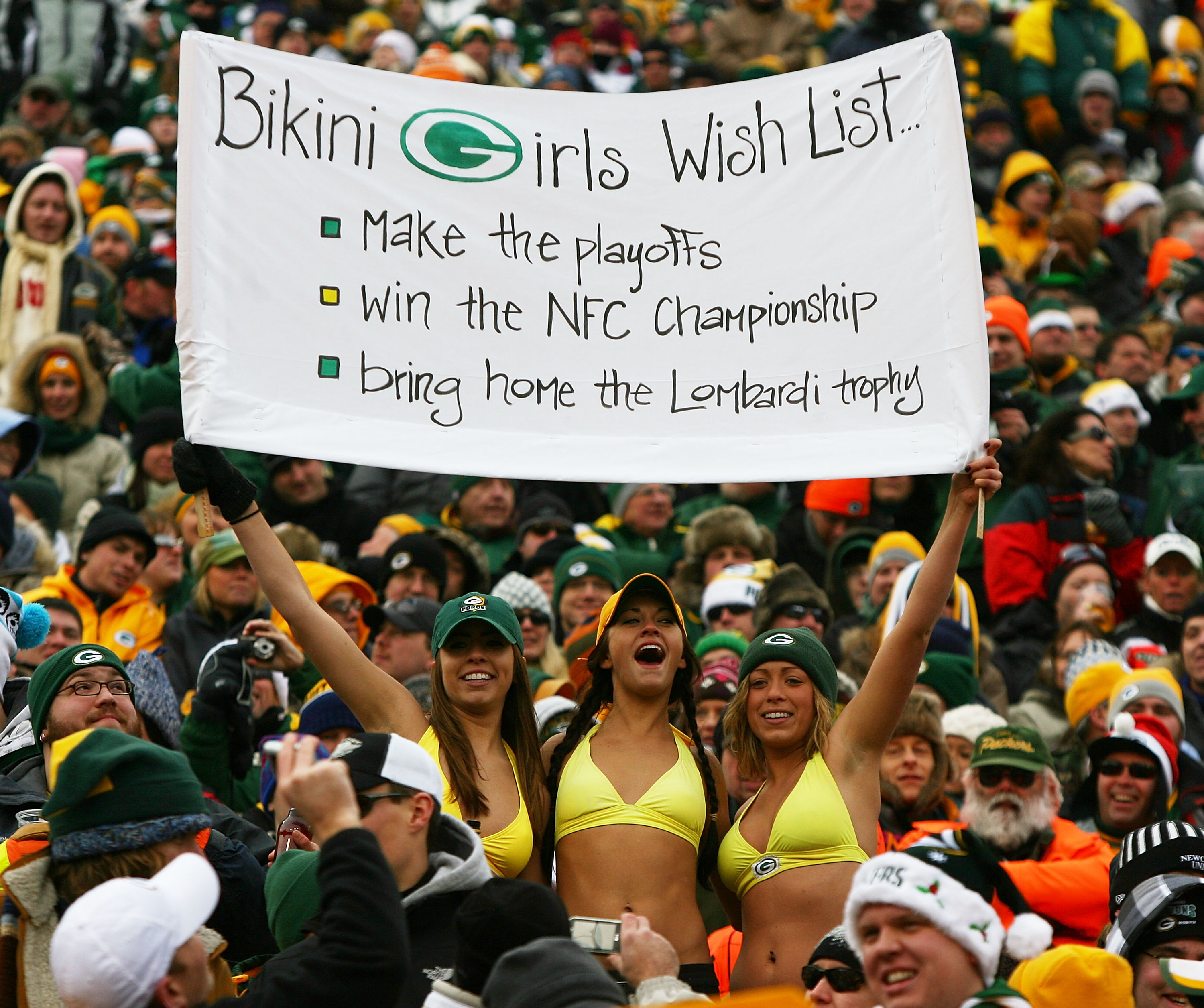GREEN BAY, WI - DECEMBER 27: Fans of the Green Bay Packers hold a sign and wear bikini's in below freezing weather during a game between the Packers and the Seattle Seahawks at Lambeau Field on December 27, 2009 in Green Bay, Wisconsin. The Packers defeat