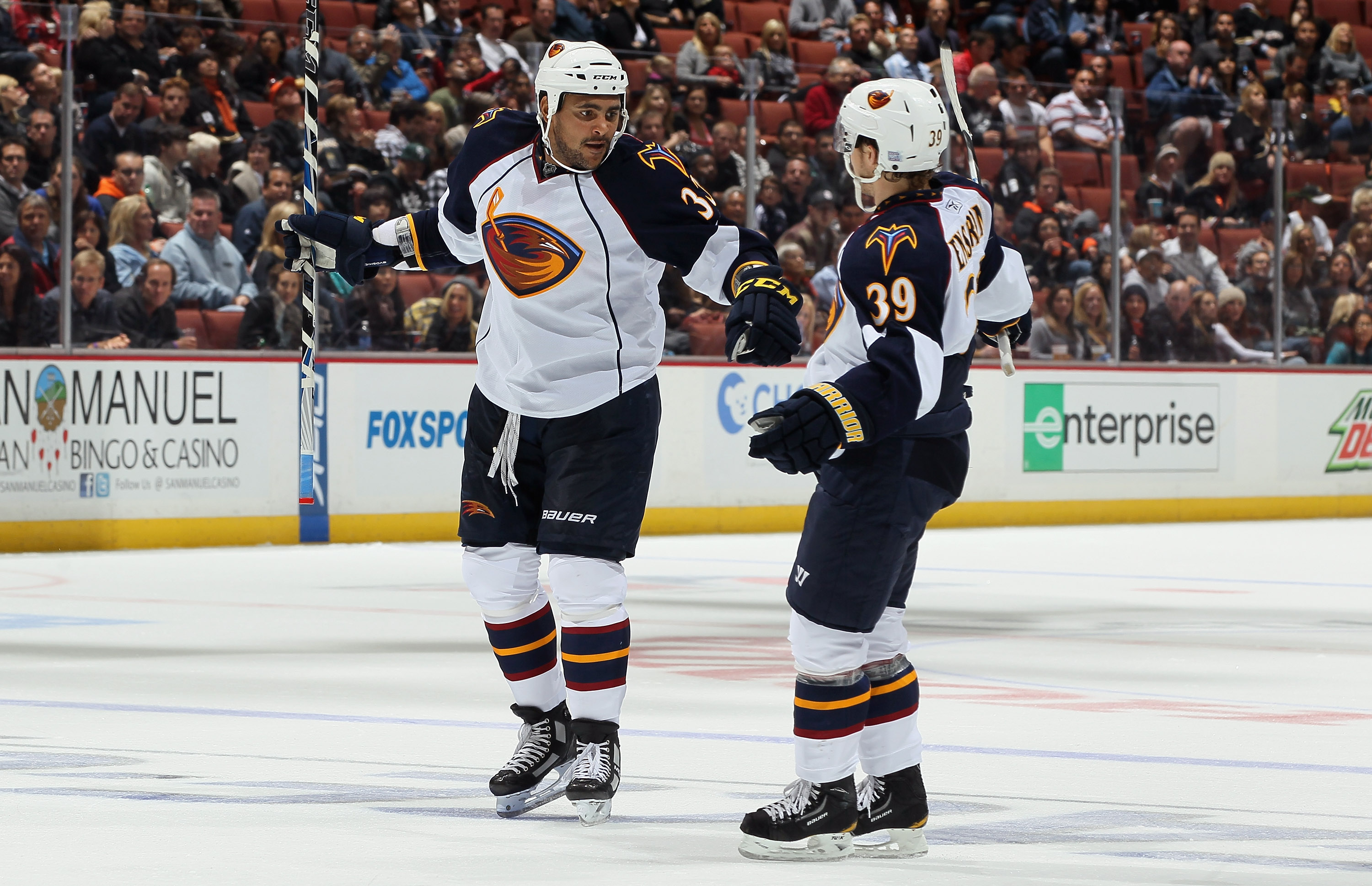 ANAHEIM, CA - OCTOBER 15:  Dustin Byfuglien #33 and Tobias Enstrom #39 of the Atlanta Thrashers celebrate a goal in the second period against the Anaheim Ducks at Honda Center on October 15, 2010 in Anaheim, California.  (Photo by Jeff Gross/Getty Images)