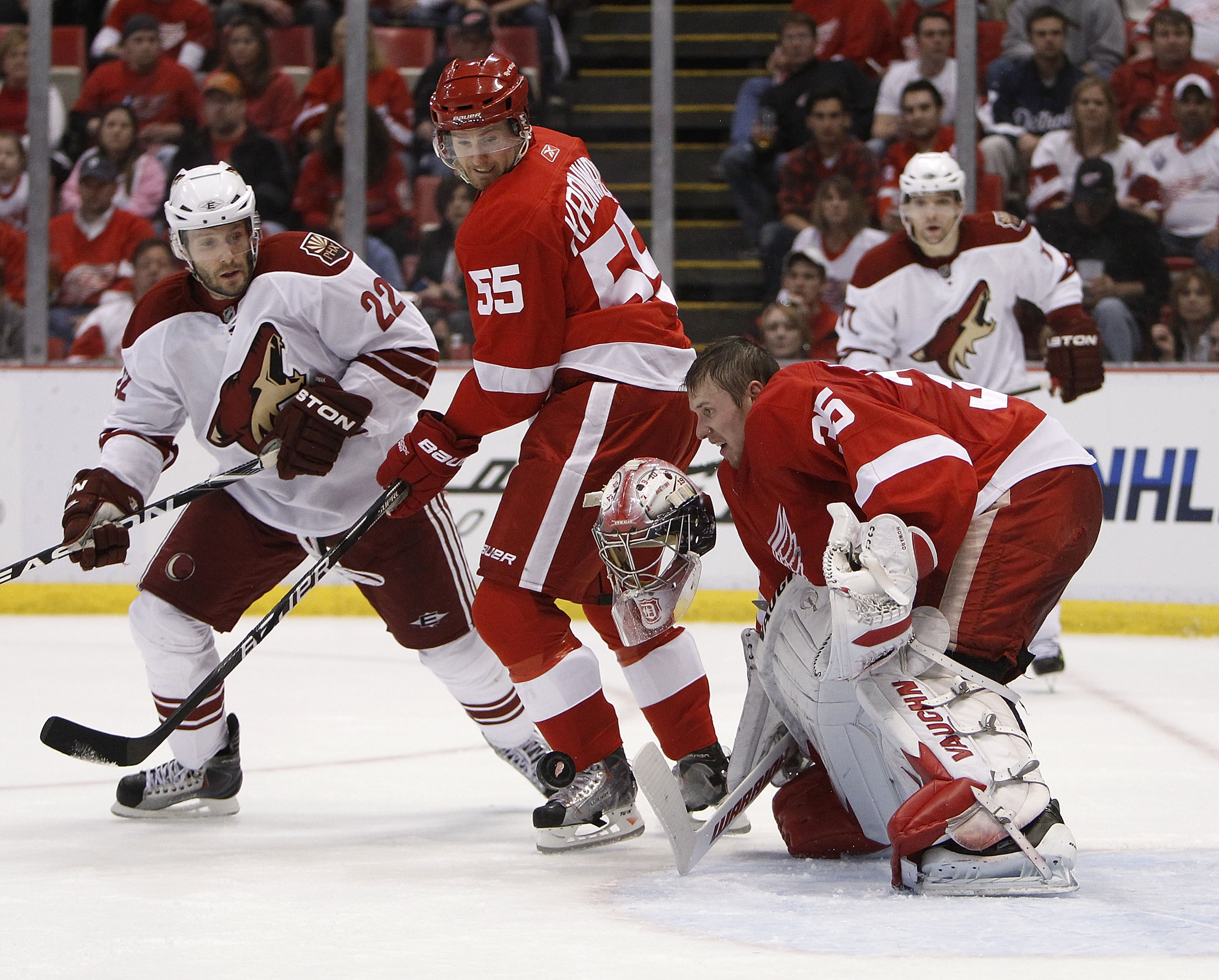 DETROIT - APRIL 20:  Jimmy Howard #35 of the Detroit Red Wings loses his mask making a save behind teammate Niklas Kronwall #55 and Lee Stempniak #22 of the Phoenix Coyotes during Game Four of the Western Conference Quarterfinals of the 2010 NHL Stanley C