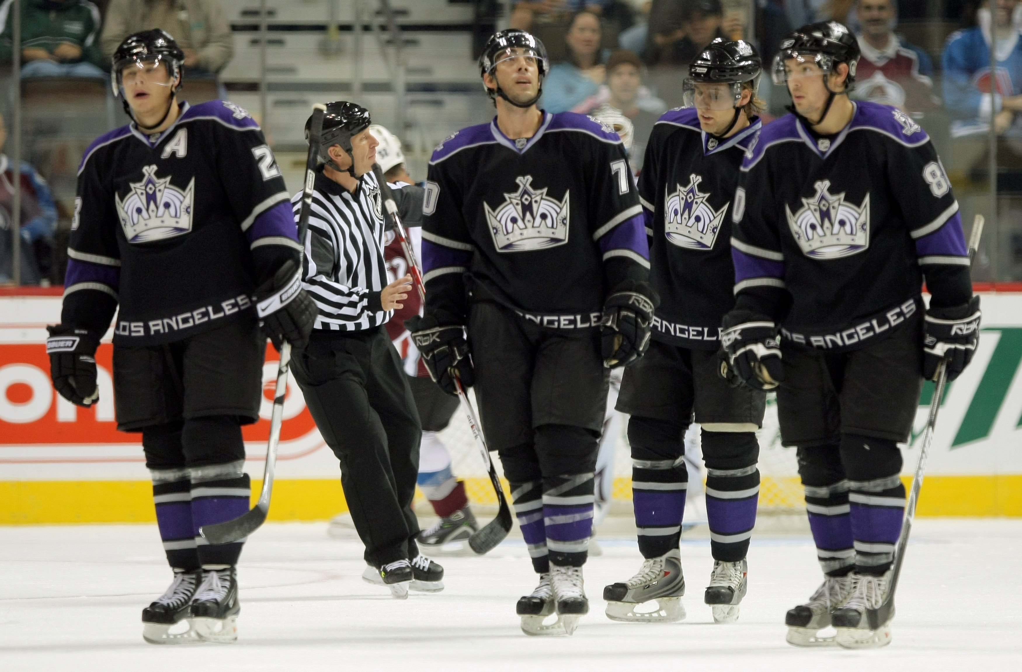 DENVER - SEPTEMBER 24:  Dustin Brown #23, Matt Moulson #70, Jack Johnson #3 and Drew Doughty #80 of the Los Angeles Kings head toward the bench after scoring against the Colorado Avalanche during NHL preseason action at the Pepsi Center on September 24, 2