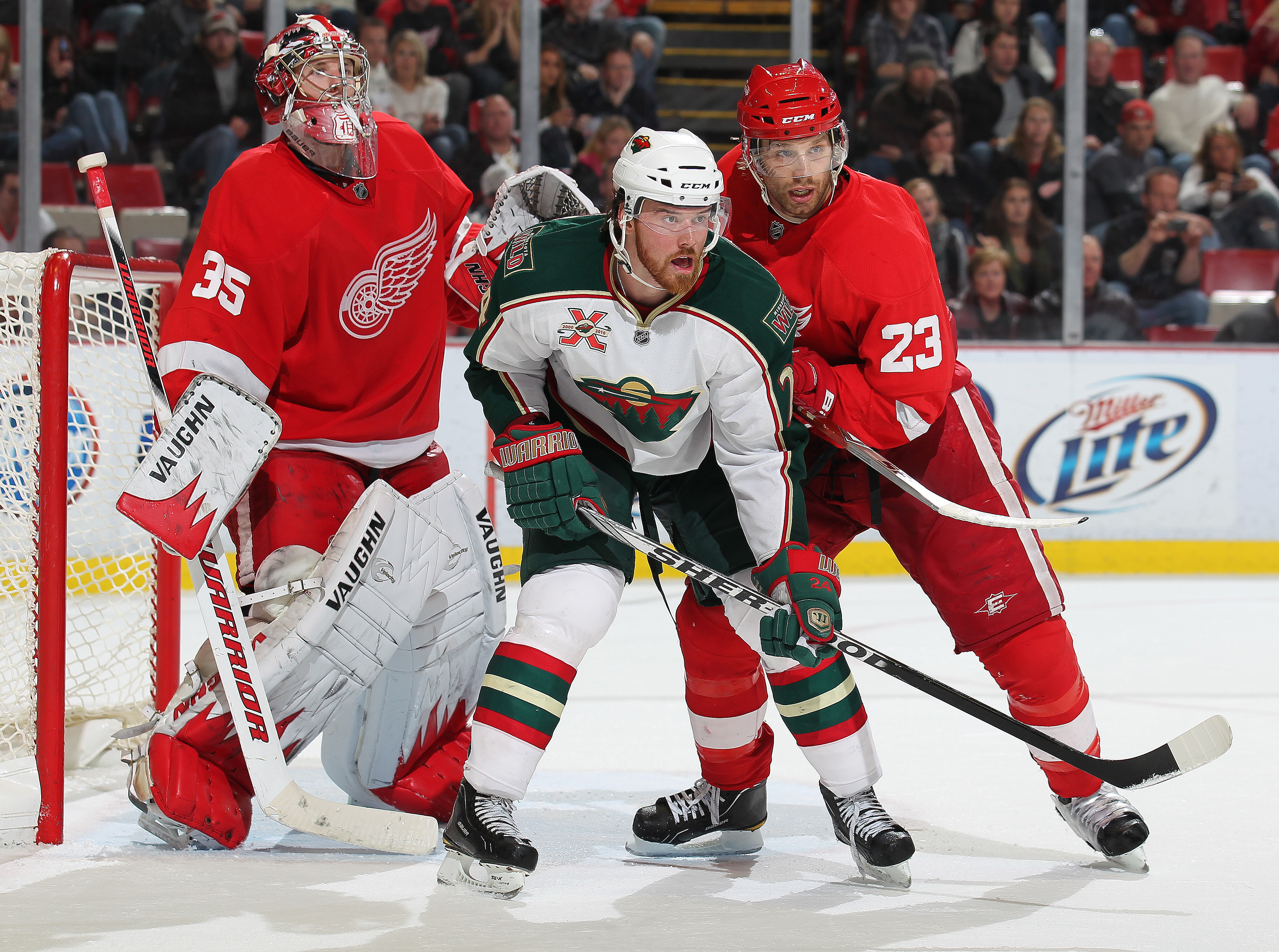 DETROIT,MI - NOVEMBER 19:  Martin Havlat #24 of the Minnesota Wild is held in check by Brad Stuart #23 of the Detroit Red Wings in a game on November 19, 2010 at the Joe Louis Arena in Detroit, Michigan. The Wild defeated the Wings 4-3 in overtime. (Photo