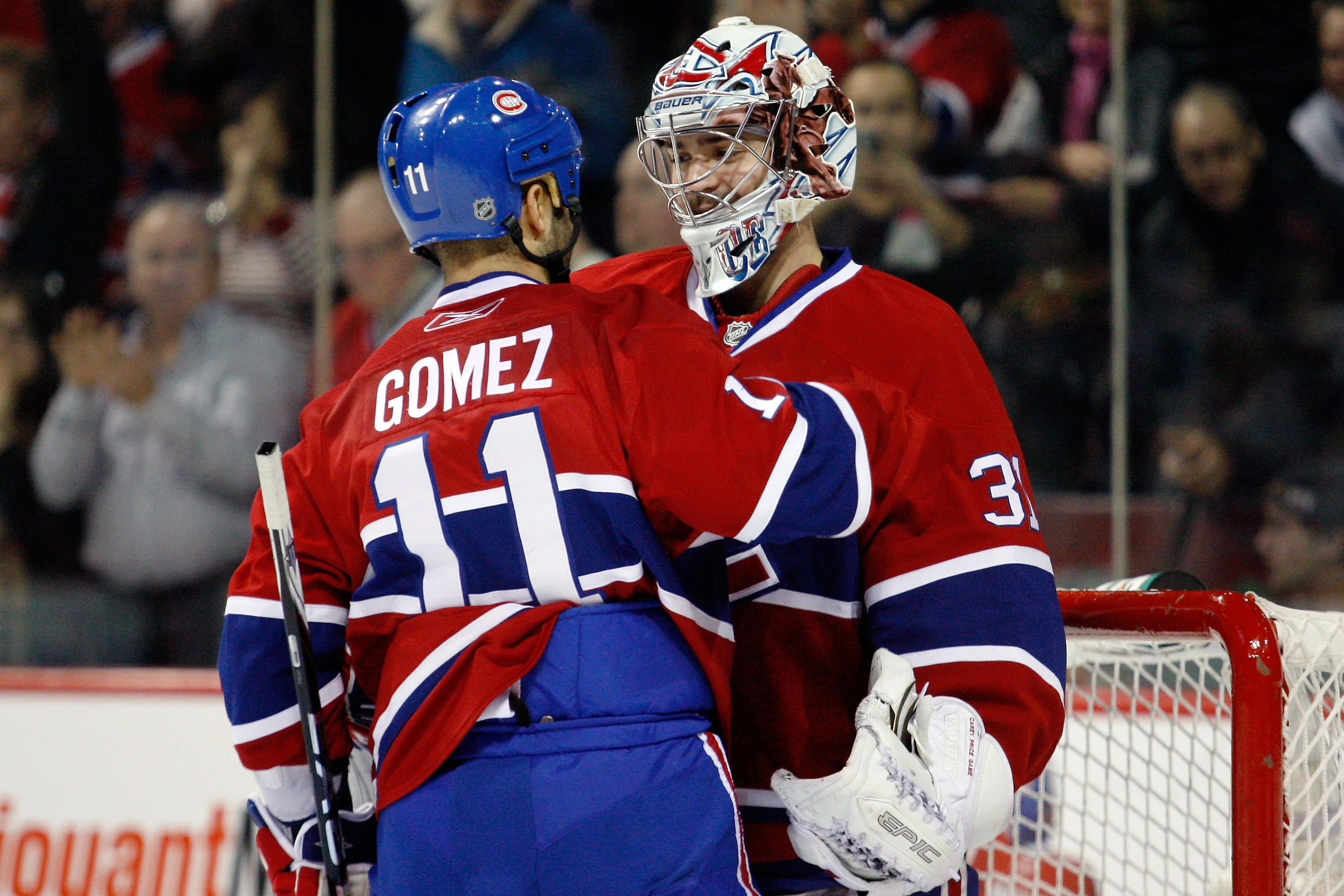 MONTREAL - NOVEMBER 20:  Scott Gomez #11 of the Montreal Canadiens congratulates teammate goalie Carey Price #31 on his shutout victory over the Toronto Maple Leafs during the NHL game at the Bell Centre on November 20, 2010 in Montreal, Quebec, Canada.